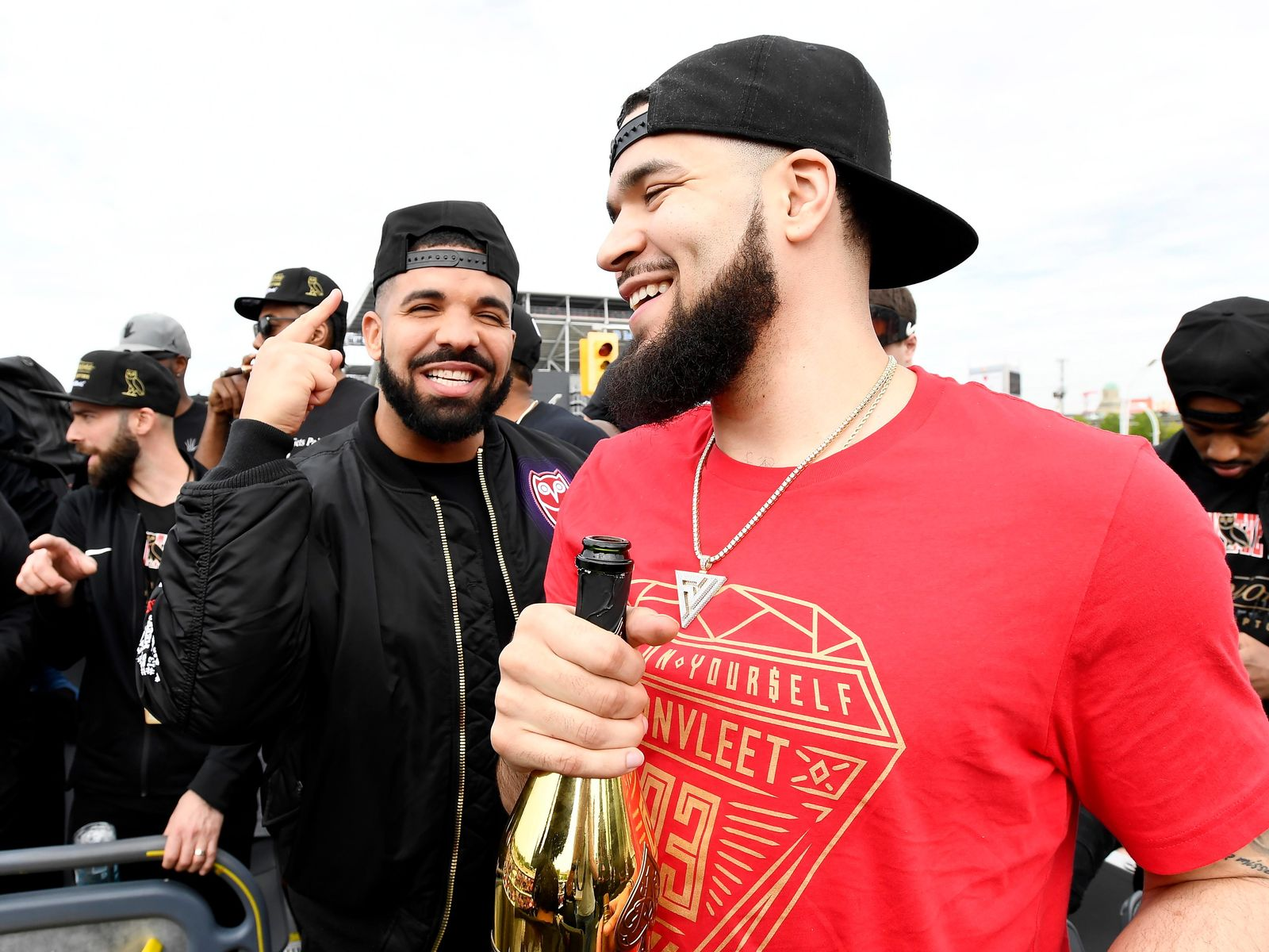 Toronto Raptors guard Fred VanVleet, right, celebrates with performing artist Drake during the 2019 Toronto Raptors NBA basketball championship parade in Toronto, Monday, June 17, 2019. (Frank Gunn/The Canadian Press via AP)