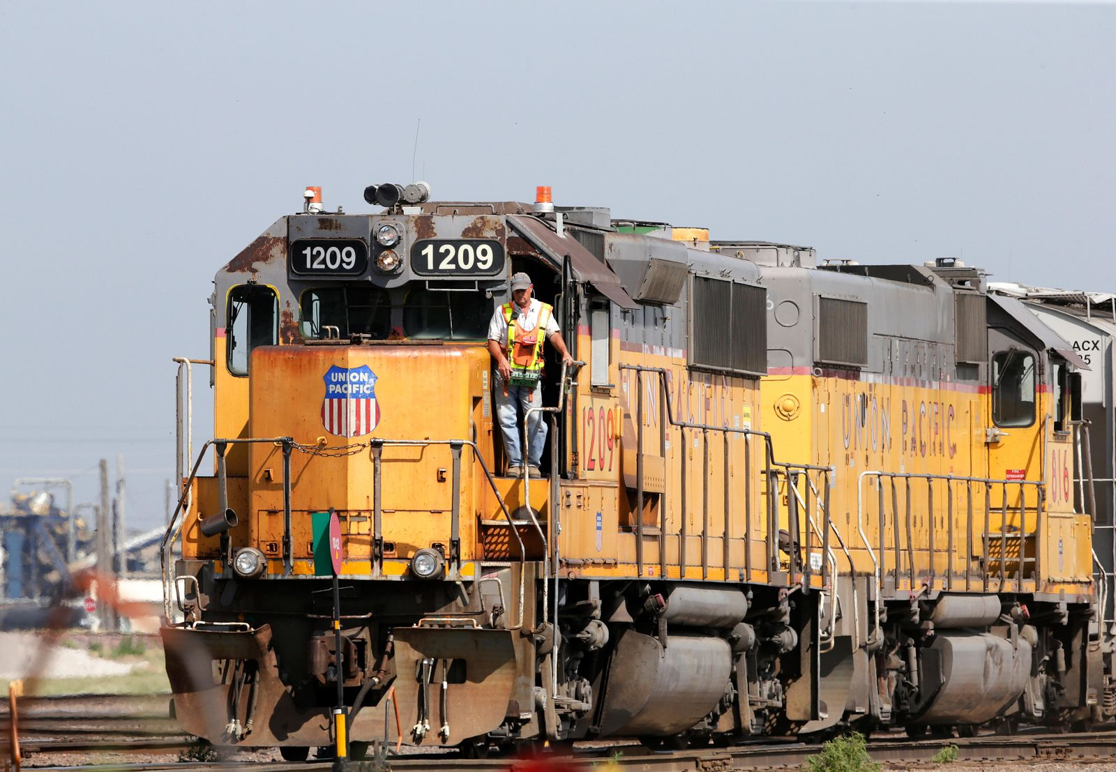 FILE - In this July 20, 2017, file photo, a Union Pacific Railroad Company employee stands on a locomotive in Council Bluffs, Iowa. More than two dozen major companies ranging from Campbell Soup to Kia filed anti-trust lawsuits on Sept. 30, 2019 against the nation's four largest railway companies, contending the railroads had a price-fixing scheme to illegally boost profits. (AP Photo/Nati Harnik, File)