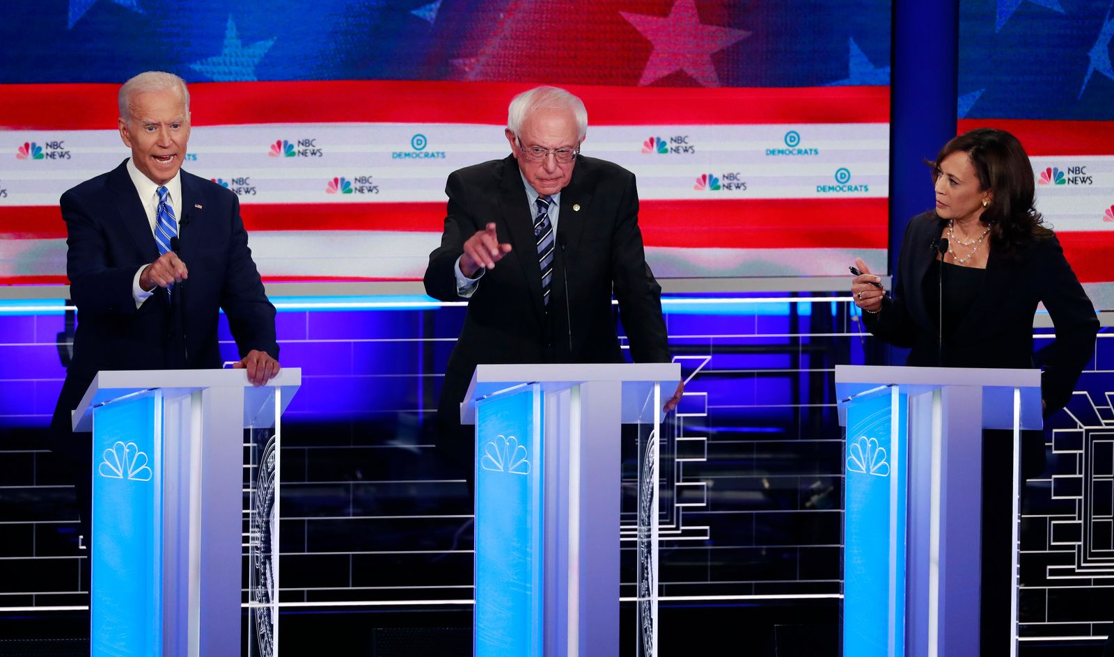 Democratic presidential candidate former vice president Joe Biden, left, Sen. Bernie Sanders, I-Vt., and Sen. Kamala Harris, D-Calif., all talk at the same time during the Democratic primary debate hosted by NBC News at the Adrienne Arsht Center for the Performing Arts, Thursday, June 27, 2019, in Miami. (AP Photo/Wilfredo Lee)