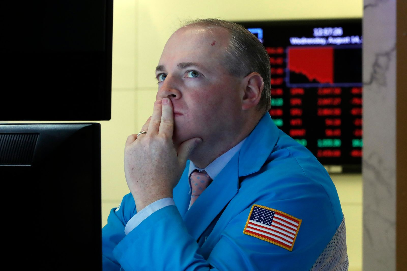 Specialist Edward Loggie works on the floor of the New York Stock Exchange, Wednesday, Aug. 14, 2019. Stocks are falling sharply after the bond market threw up another warning flag on the economy. (AP Photo/Richard Drew)