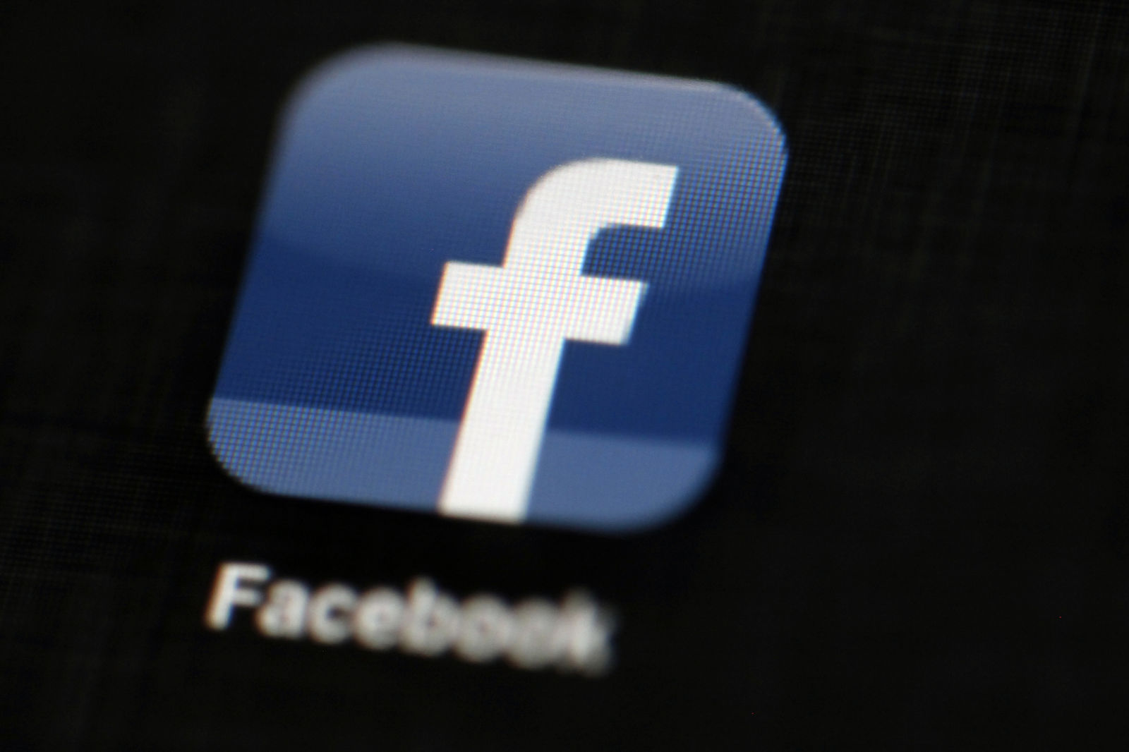FILE - In this May 16, 2012, file photo, the Facebook logo is displayed on an iPad in Philadelphia.  Facebook has removed hundreds more social media accounts that it says belonged to members of two different white supremacy groups.{ } (AP Photo/Matt Rourke, File)