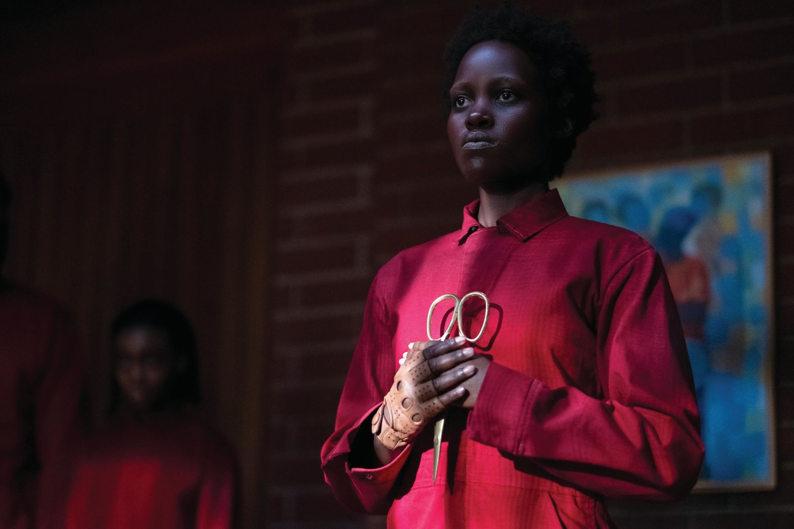"Adelaide Wilson doppelgänger Red (Lupita Nyong'o, foreground) and Zora Wilson doppelgänger Umbrae (background, left) in ""Us,"" written, produced and directed by Jordan Peele.{ }(Photo: Universal Pictures)"