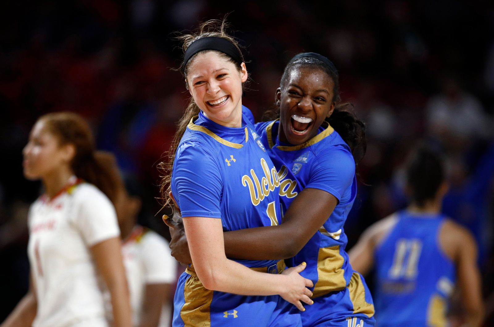 UCLA guard Lindsey Corsaro, left, and forward Michaela Onyenwere celebrate after a second-round game against Maryland in the NCAA women's college basketball tournament Monday, March 25, 2019, in College Park, Md. UCLA won 85-80. (AP Photo/Patrick Semansky)
