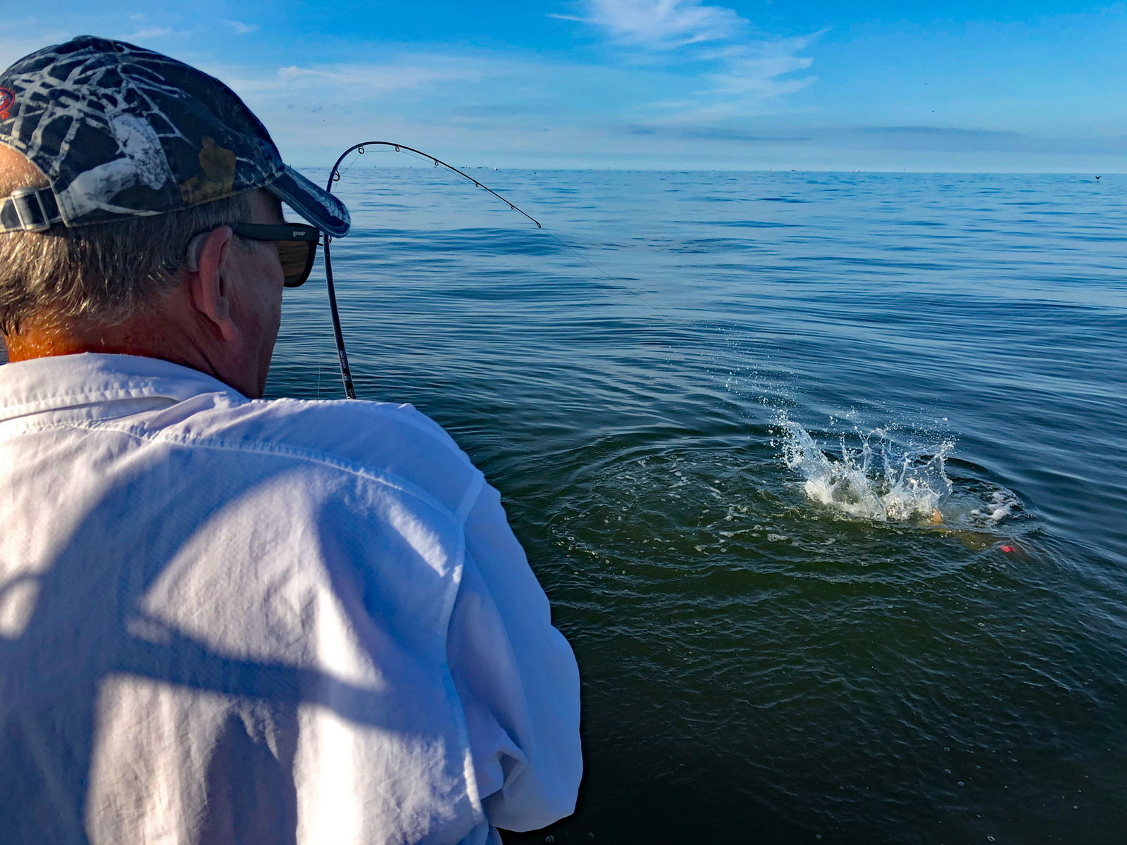 Ed McCoy does battle with one of the first bull redfish of our trip. Folks who have never fought redfish can't really comprehend the power of these amazing fighters. (Photo: Richard Simms)