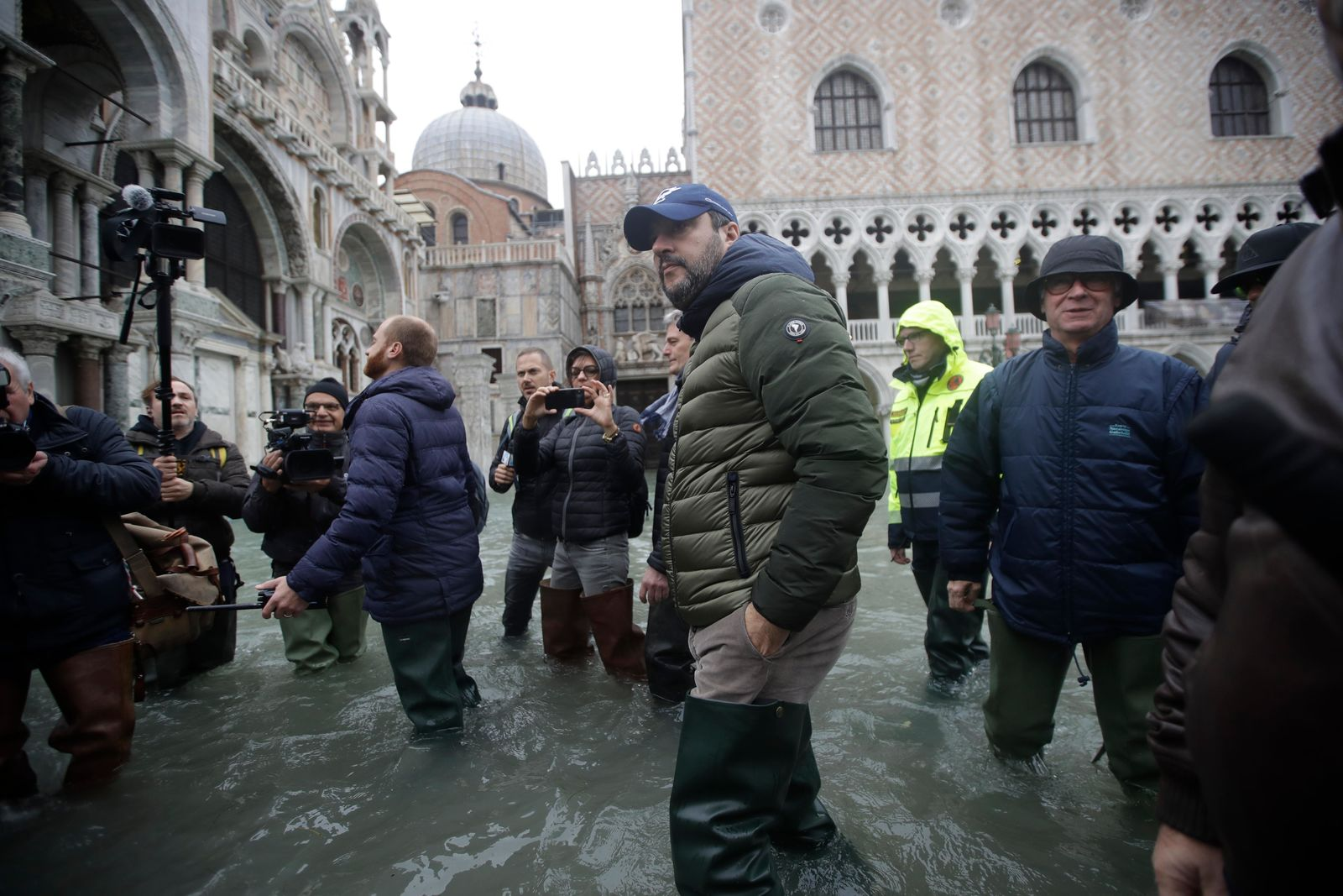 The League leader Matteo Salvini walks in a flooded St. Mark's Square at Venice, Italy, Friday, Nov. 15, 2019. (AP Photo/Luca Bruno)