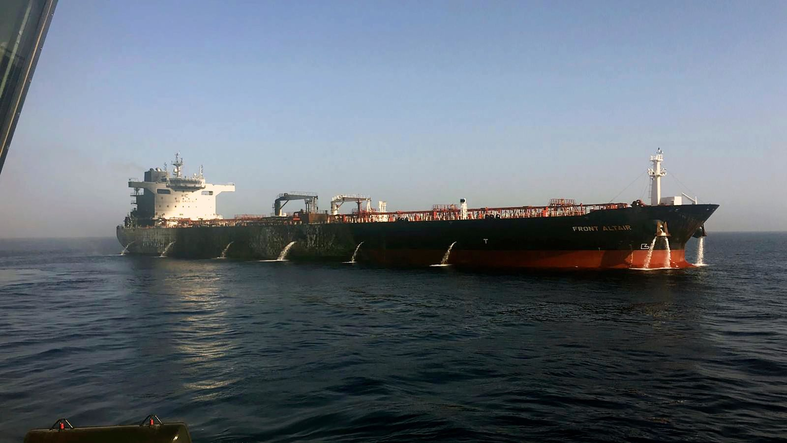 In this photo dated Thursday June 13, 2019, made available by the Norwegian shipowner Frontline, showing the crude oil tanker Front Altair after the fire aboard was extinguished onboard the Norwegian ship in the Gulf of Oman.  The U.S. Navy rushed to assist the stricken vessels in the Gulf of Oman, off the coast of Iran, as two oil tankers came under suspected attack amid heightened tension between Iran and the U.S. (Frontline via AP)
