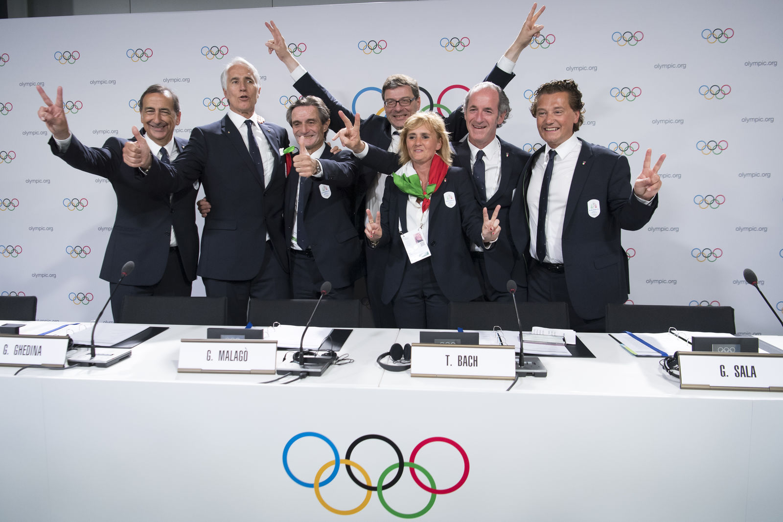 From left, the Mayor of Milan Giuseppe Sala, Italy's National Olympic Committee (CONI) president Giovanni Malago, Italy's Lombardy region President Attilio Fontana, Italy's Under Secretary of State Giancarlo Giorgetti, Italy's Olympic Gold Medallist in Fencing Diana Bianchedi, Italy's Veneto Region President Luca Zaia and Mayor of Cortina Gianpietro Ghedina pose after Milan-Cortina won the bid to host the 2026 Winter Olympic Games, during the first day of the 134th Session of the International Olympic Committee (IOC), at the SwissTech Convention Centre, in Lausanne, Switzerland, Monday, June 24, 2019.{ } (Laurent Gillieron/Keystone via AP)