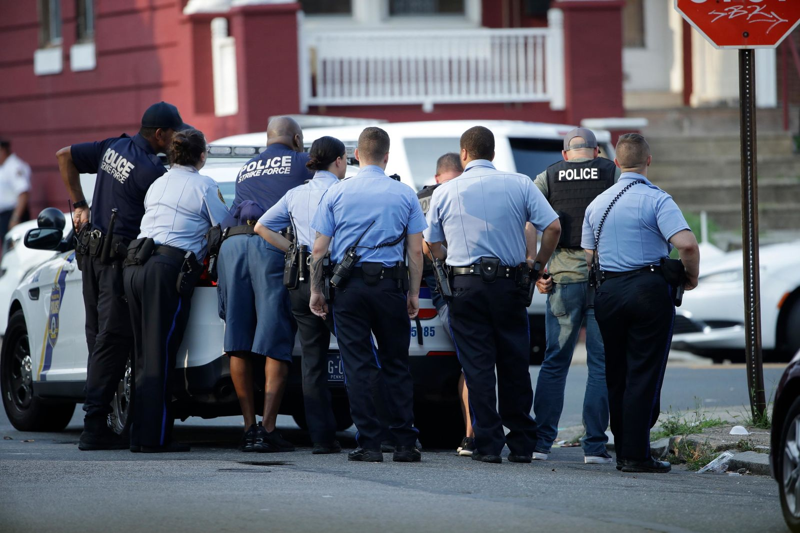 Philadelphia police stage as they respond to an active shooting situation, Wednesday, Aug. 14, 2019, in the Nicetown neighborhood of Philadelphia. (AP Photo/Matt Rourke)