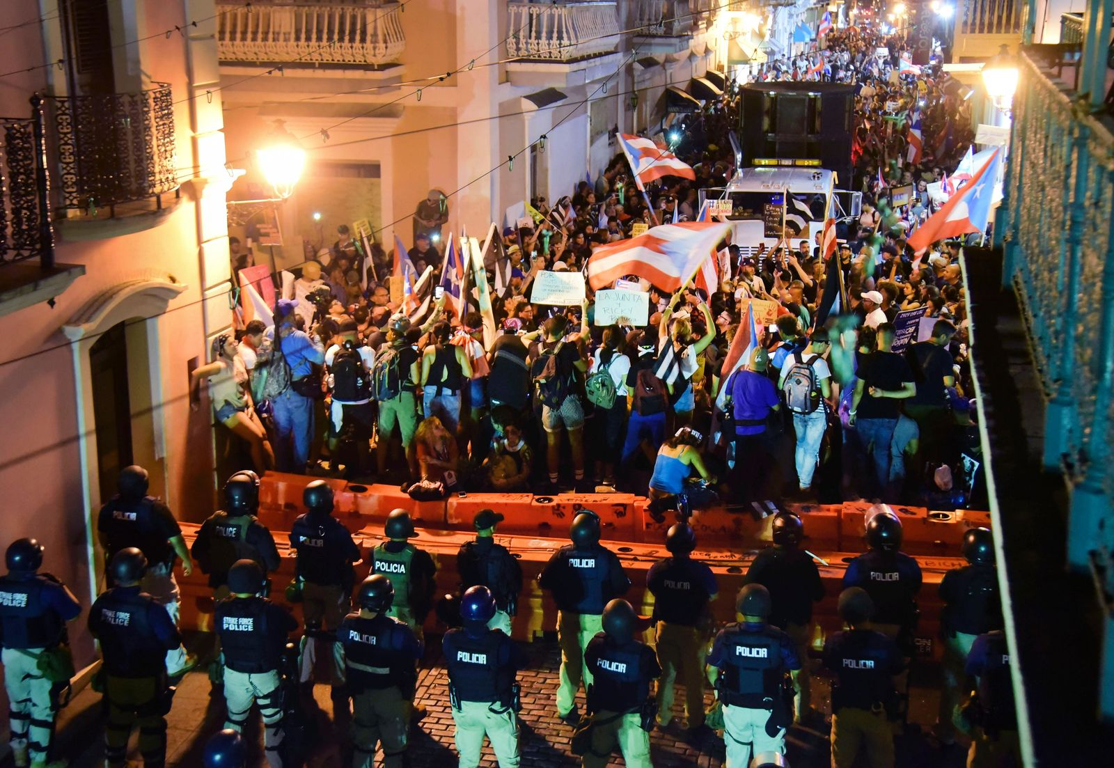 Demonstrators protest against governor Ricardo Rossello, in San Juan, Puerto Rico, Friday, July 19, 2019. Protesters are demanding Rossello step down for his involvement in a private chat in which he used profanities to describe an ex-New York City councilwoman and a federal control board overseeing the island's finance. (AP Photo/Carlos Giusti)