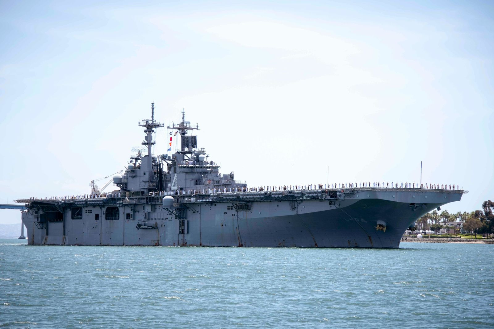 In this May 1, 2019, photo provided by the U.S. Navy, the amphibious assault ship USS Boxer (LHD 4) transits the San Diego Bay in San Diego, Calif. President Donald Trump says the USS Boxer destroyed an Iranian drone in the Strait of Hormuz amid heightened tensions between the two countries.{ } (Mass Communication Specialist 2nd Class Jesse Monford/U.S. Navy via AP)