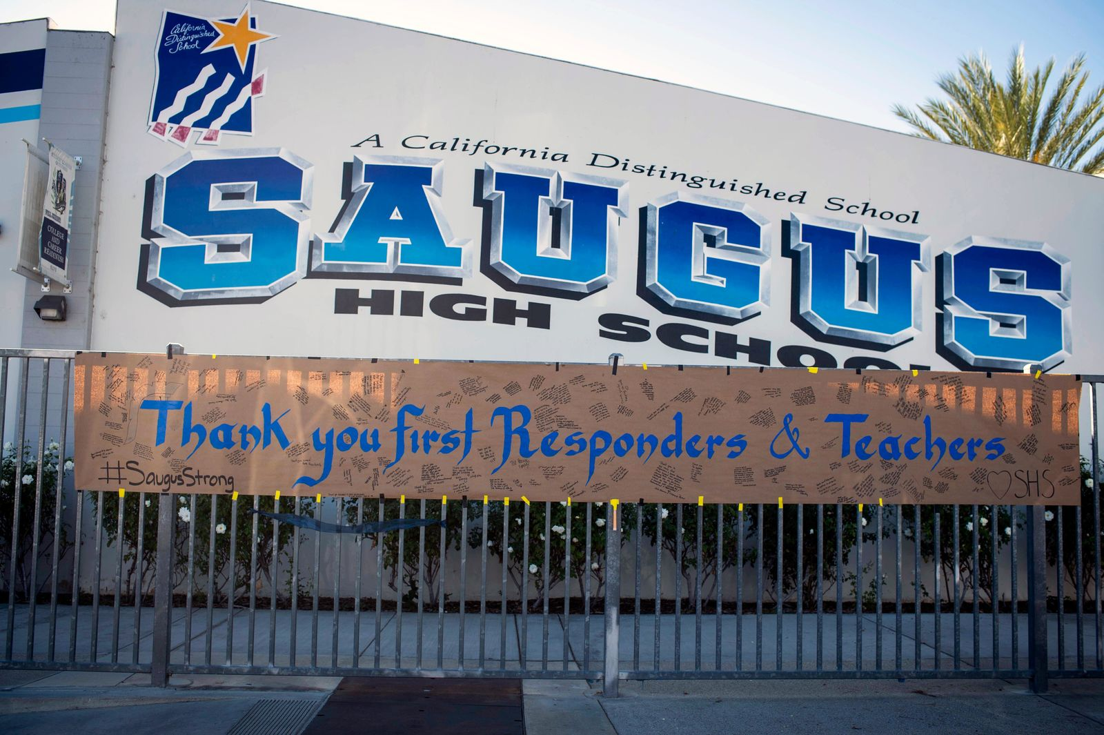 A sign thanking first responders and teachers hangs, Monday, Nov. 18, 2019, after two students were killed during a shooting at Saugus High School in Santa Clarita, Calif., several days earlier. Students will return to school on Dec. 2. (Sarah Reingewirtz/The Orange County Register via AP)