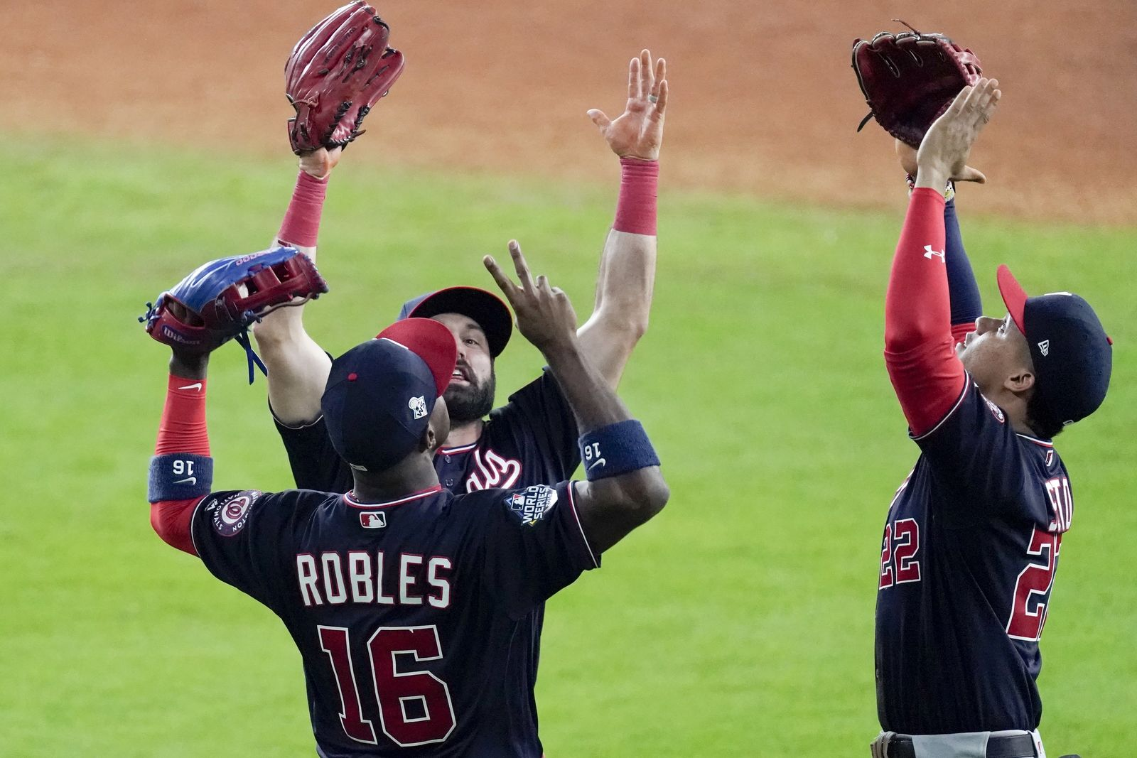 Washington Nationals' Juan Soto, Washington Nationals 2 and Victor Robles celebrate after Game 1 of the baseball World Series against the Houston Astros Tuesday, Oct. 22, 2019, in Houston. The Nationals won 5-4 to take a 1-0 lead in the series. (AP Photo/Eric Gay)