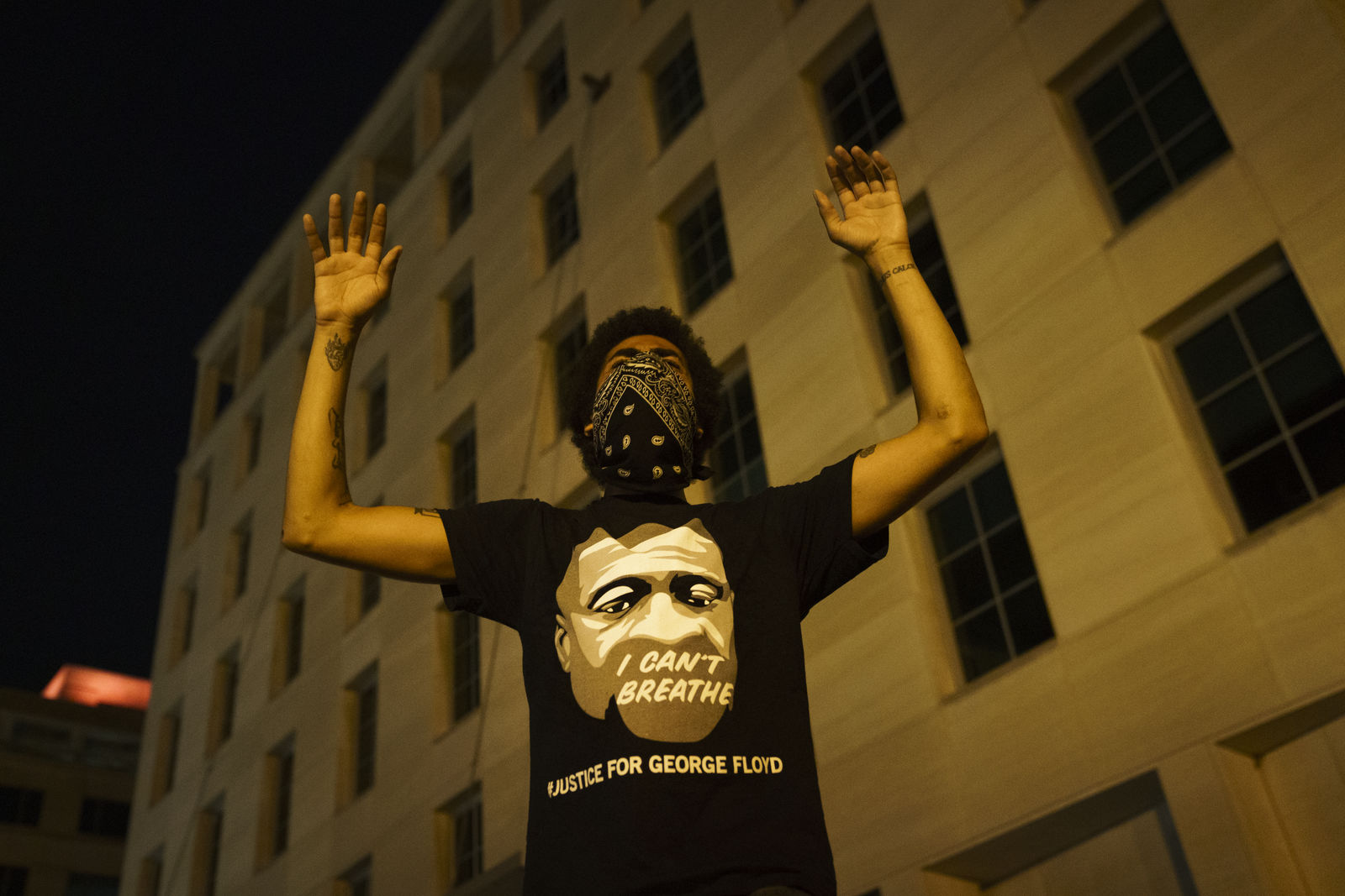 WASHINGTON, DC - JUNE 03: A demonstrator holds his hands up in protest near Lafayette Park and the White House on June 3, 2020 in Washington, DC. Protests in cities throughout the country continue in the wake of the death of George Floyd, a black man who was killed in police custody in Minneapolis on May 25. (Photo by Drew Angerer/Getty Images)