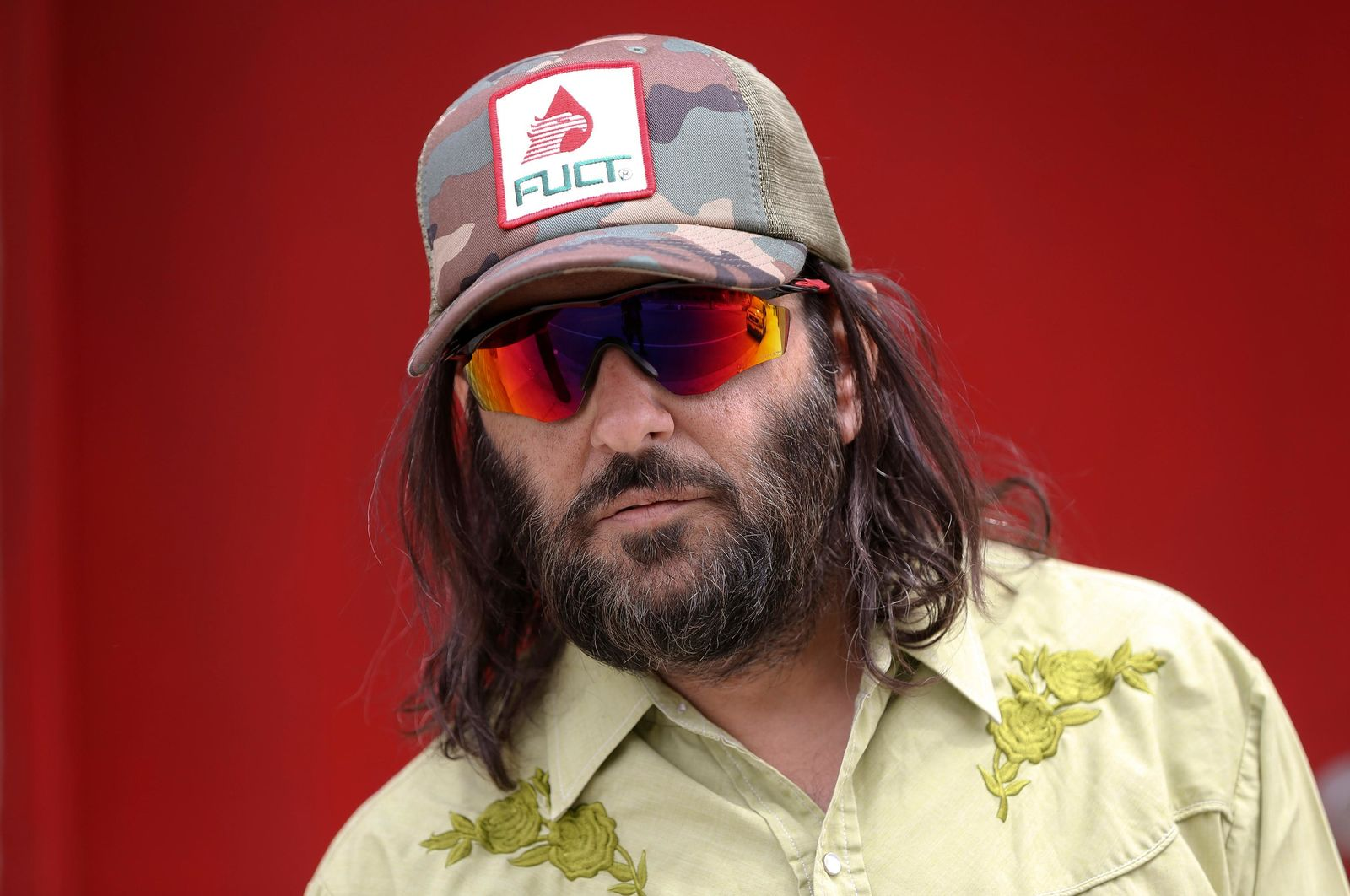 "Los Angeles artist Erik Brunetti, the founder of the streetwear clothing company ""FUCT,"" poses for a photo in Los Angeles Thursday, April, 11, 2019. ""We wanted the viewer to question it: Like, is that pronounced the way I think it's pronounced?"" he said of his streetwear brand ""FUCT,"" which began selling clothing in 1991. On April 15, the Supreme Court will hear Brunetti's challenge to a part of federal law that says officials should refuse to register trademarks that are ""scandalous"" or ""immoral."" (AP Photo/Damian Dovarganes)"