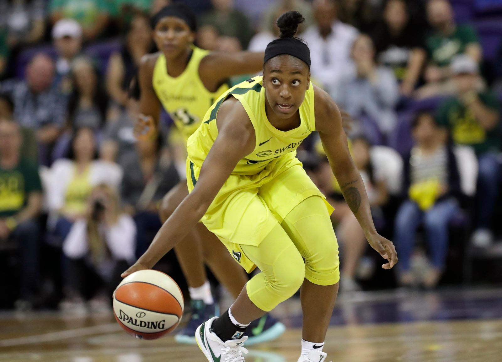 Seattle Storm's Jewell Loyd brings the ball up against the Las Vegas Aces during the first half of a WNBA basketball game Friday, July 19, 2019, in Seattle. (AP Photo/Elaine Thompson)