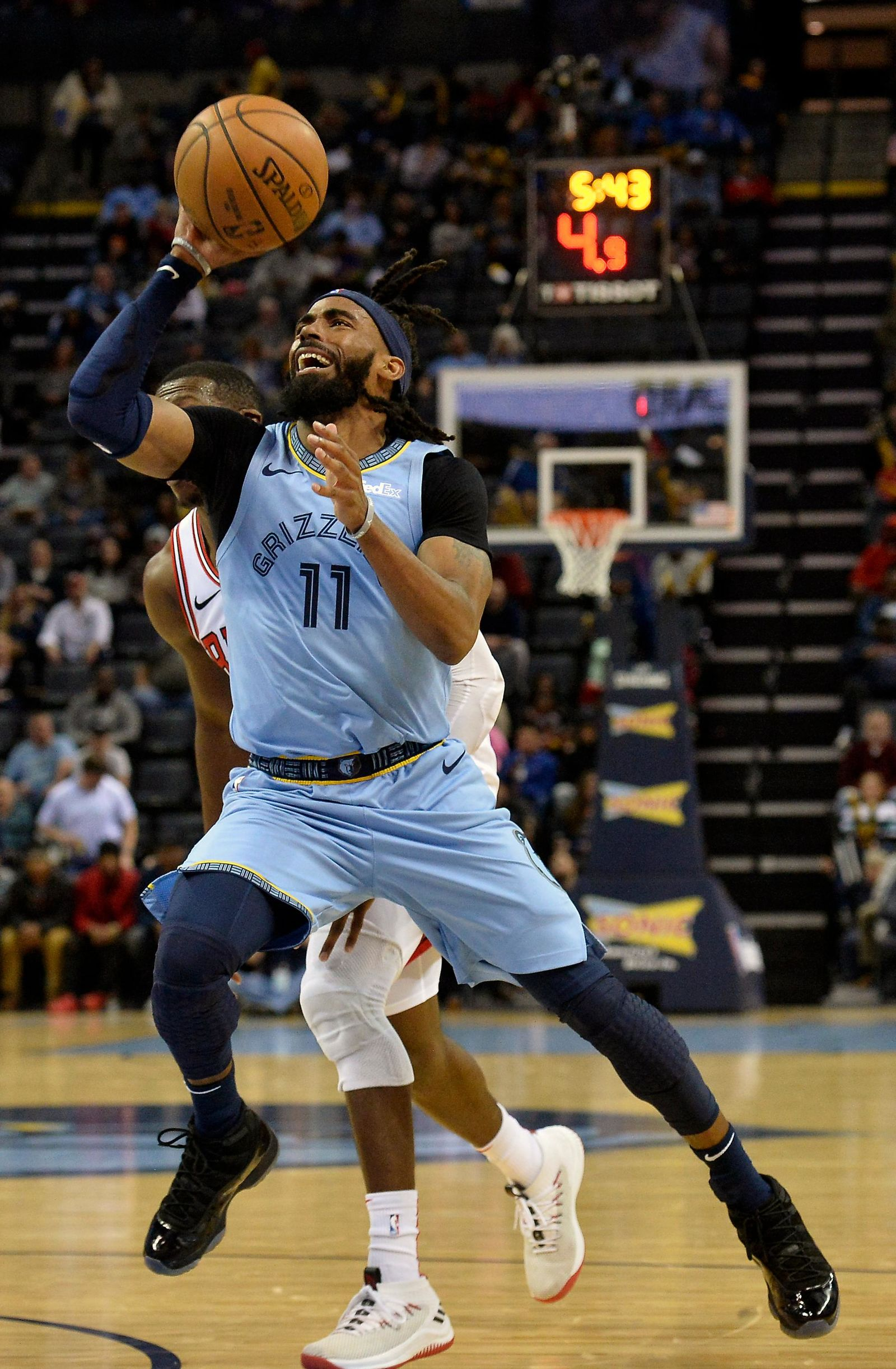 FILE - In this Feb. 27, 2019, file photo, Memphis Grizzlies guard Mike Conley (11) shoots the ball in the first half of an NBA basketball game against the Chicago Bulls, in Memphis, Tenn. A person with knowledge of the decision says the Memphis Grizzlies have traded veteran point guard Mike Conley, who has played the most games in franchise history, to the Utah Jazz. The person says the Grizzlies swapped Conley for Jae Crowder, Kyle Korver and Grayson Allen. The person spoke to The Associated Press Wednesday, June 19, 2019, on condition of anonymity because neither Memphis nor Utah has announced the trade. (AP Photo/Brandon Dill, File)