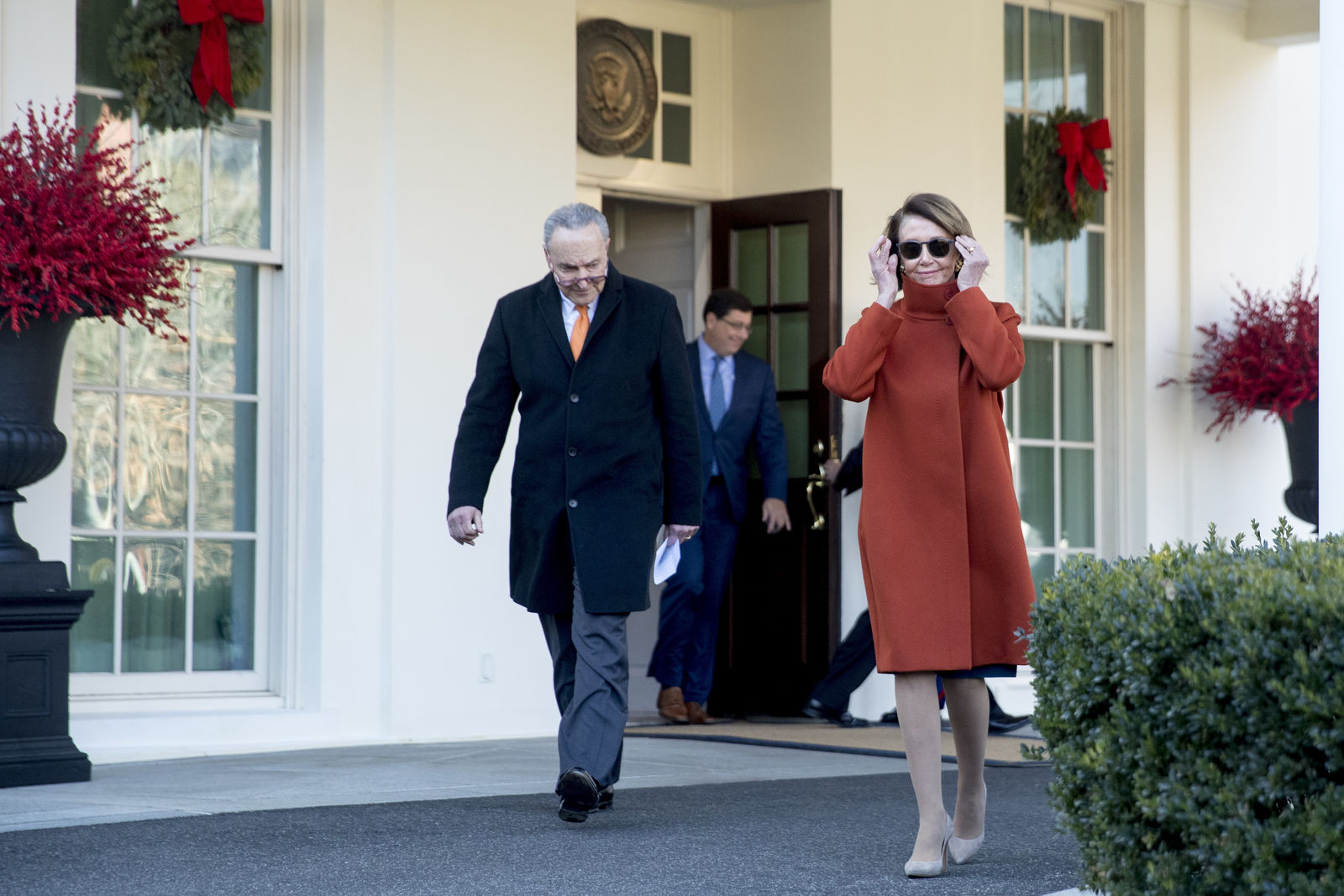 House Minority Leader Nancy Pelosi of Calif., right, and Senate Minority Leader Sen. Chuck Schumer of N.Y., left, walk out of the West Wing to speak to members of the media outside of the White House in Washington, Tuesday, Dec. 11, 2018, following a meeting with President Donald Trump. (AP Photo/Andrew Harnik)