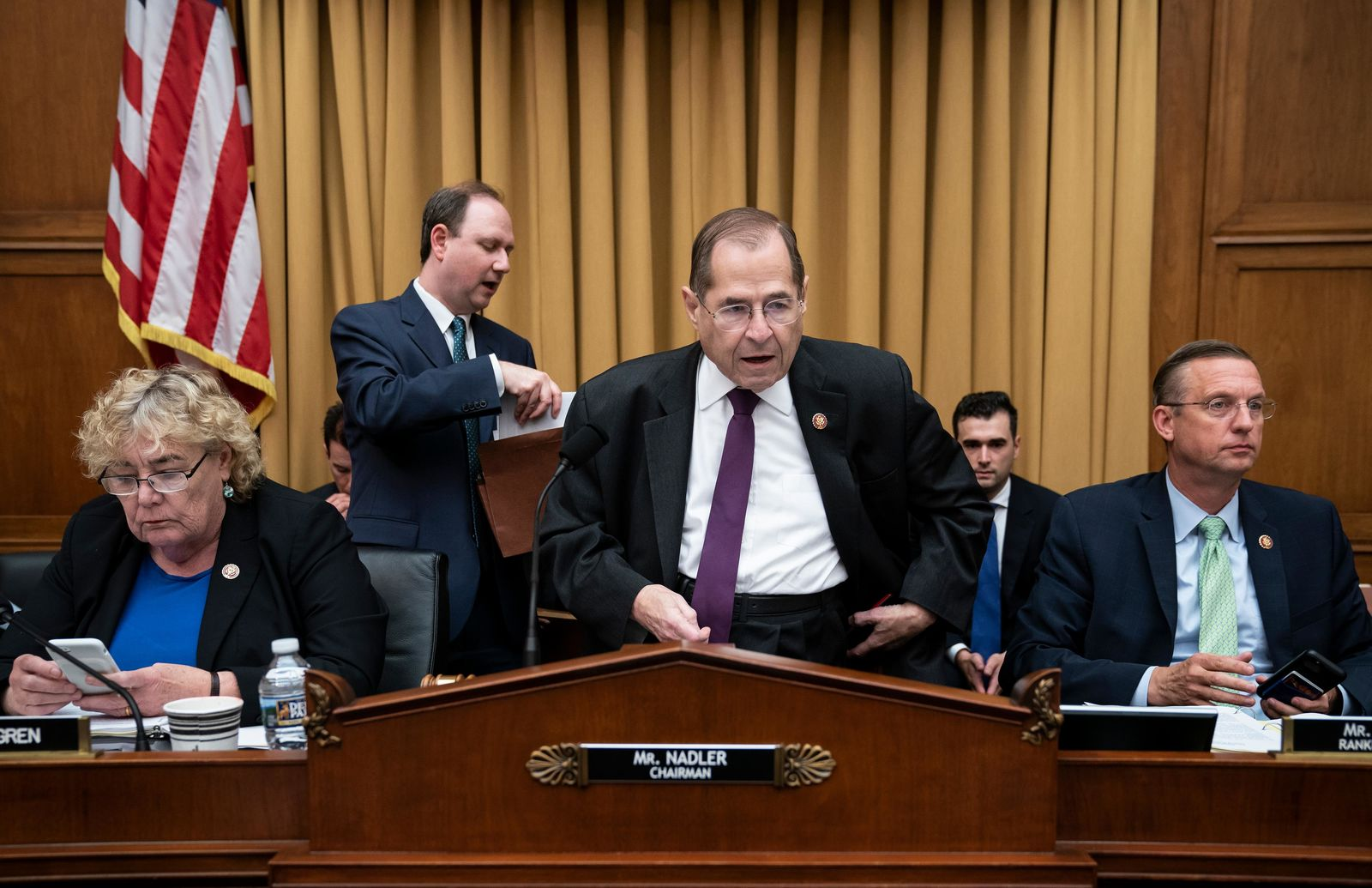 House Judiciary Committee Chairman, Rep. Jerrold Nadler, D-N.Y., flanked by Rep. Zoe Lofgren, D-Calif., left, and Rep. Doug Collins, R-Georgia, the ranking member, arrives to begin a hearing to examine whether President Donald Trump obstructed justice, the first of several hearings scheduled by Democrats on special counsel Robert Mueller's report, on Capitol Hill in Washington, Monday, June 10, 2019. The panel will focus on testimony from former White House counsel John Dean, a star witness from Watergate who helped bring down Richard Nixon's presidency. (AP Photo/J. Scott Applewhite)