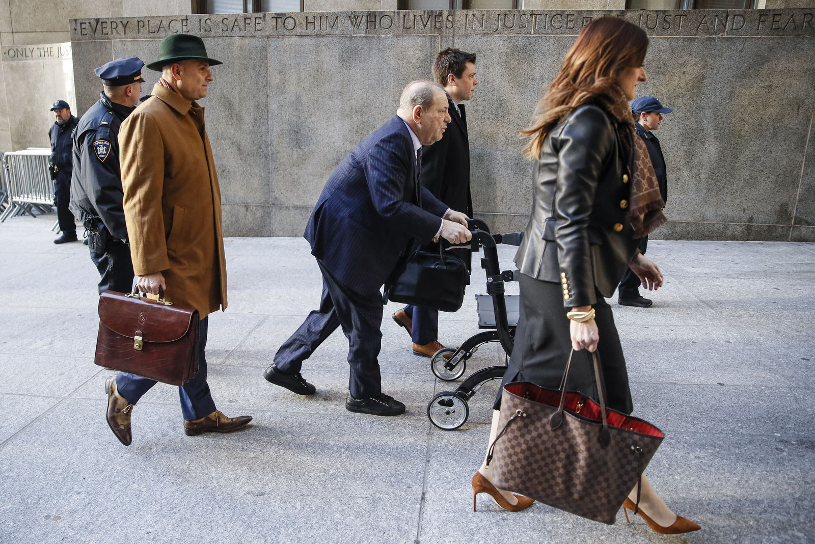 Harvey Weinstein arrives at a Manhattan courthouse as jury deliberations continue in his rape trial, Wednesday, Feb. 19, 2020, in New York.  (AP Photo/John Minchillo)