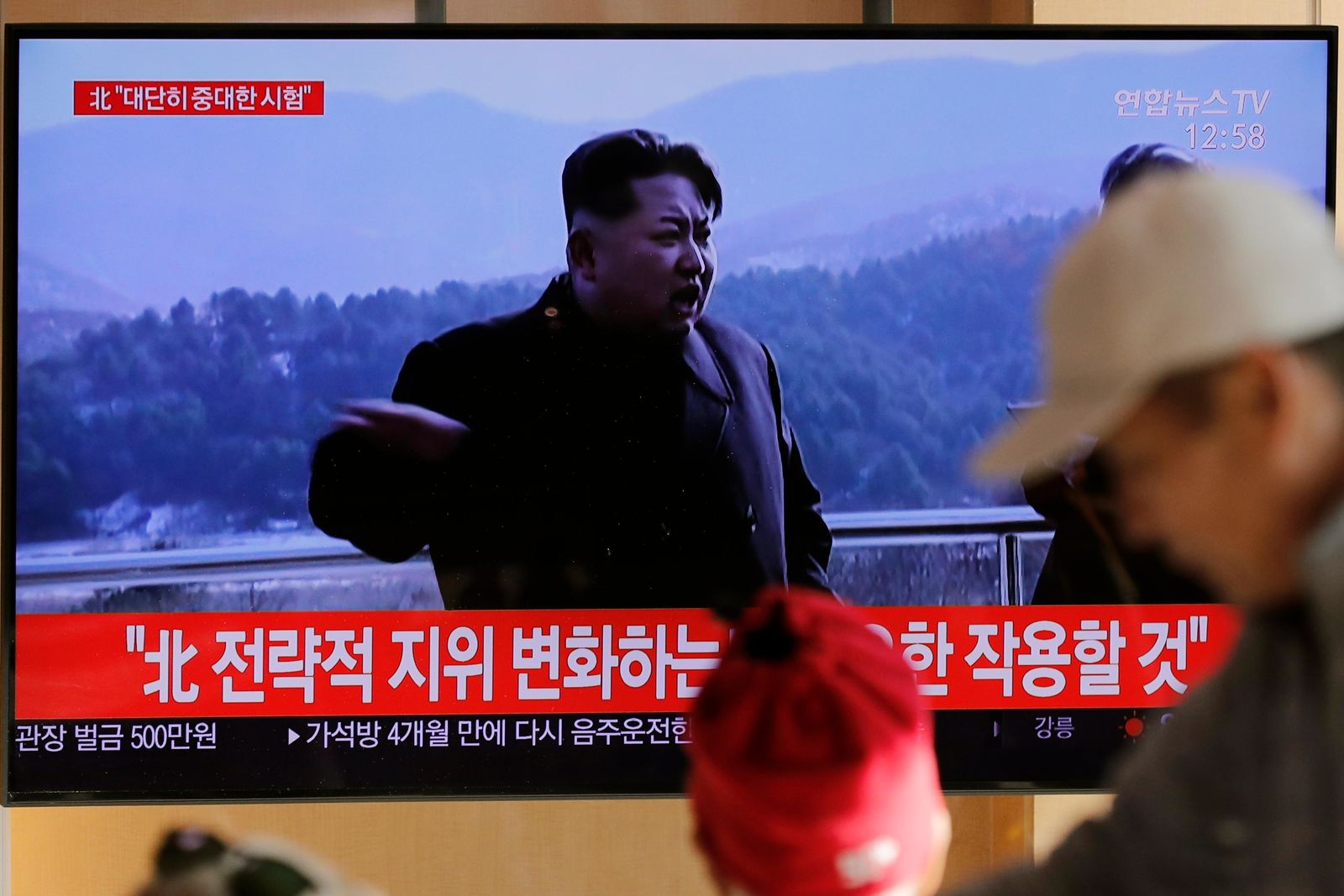 "People watch a TV news program reporting North Korea's announcement with a file footage of North Korean leader Kim Jong Un, at the Seoul Railway Station in Seoul, South Korea, Sunday, Dec. 8, 2019. North Korea said Sunday it carried out a ""very important test"" at its long-range rocket launch site that U.S. and South Korean officials said the North had partially dismantled as part of denuclearization steps. The letters, top left, read ""North. Very important test."" (AP Photo/Lee Jin-man)"