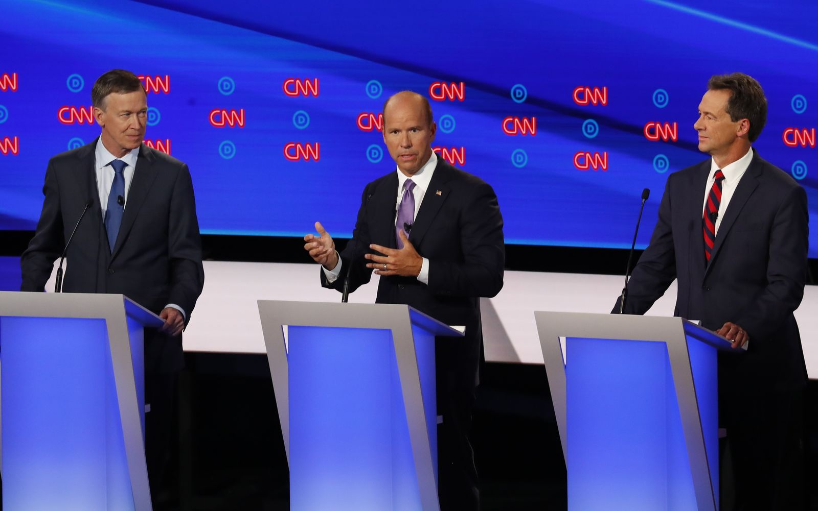 Former Colorado Gov. John Hickenlooper, former Maryland Rep. John Delaney and Montana Gov. Steve Bullock participate in the first of two Democratic presidential primary debates hosted by CNN Tuesday, July 30, 2019, in the Fox Theatre in Detroit. (AP Photo/Paul Sancya)