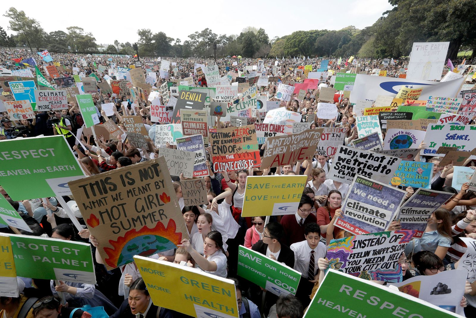 Thousands of protestors, many of them school students, gather in Sydney, Friday, Sept. 20, 2019, calling for action to guard against climate change.{ } (AP Photo/Rick Rycroft)