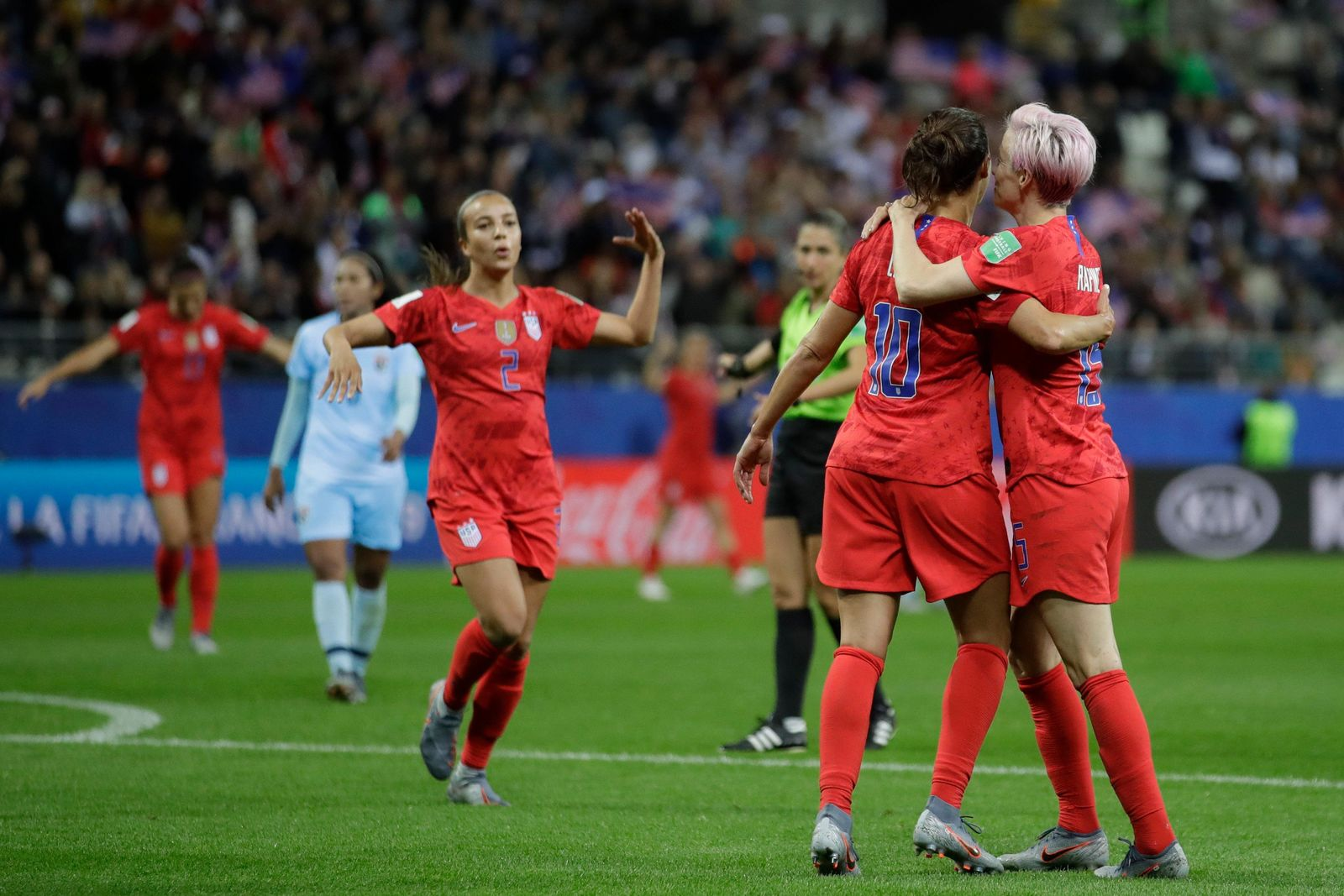 United States' Carli Lloyd, second from left, celebrates with her teammate Megan Rapinoe after scoring her side's 13th goal, during the Women's World Cup Group F soccer match between United States and Thailand at the Stade Auguste-Delaune in Reims, France, Tuesday, June 11, 2019. (AP Photo/Alessandra Tarantino)