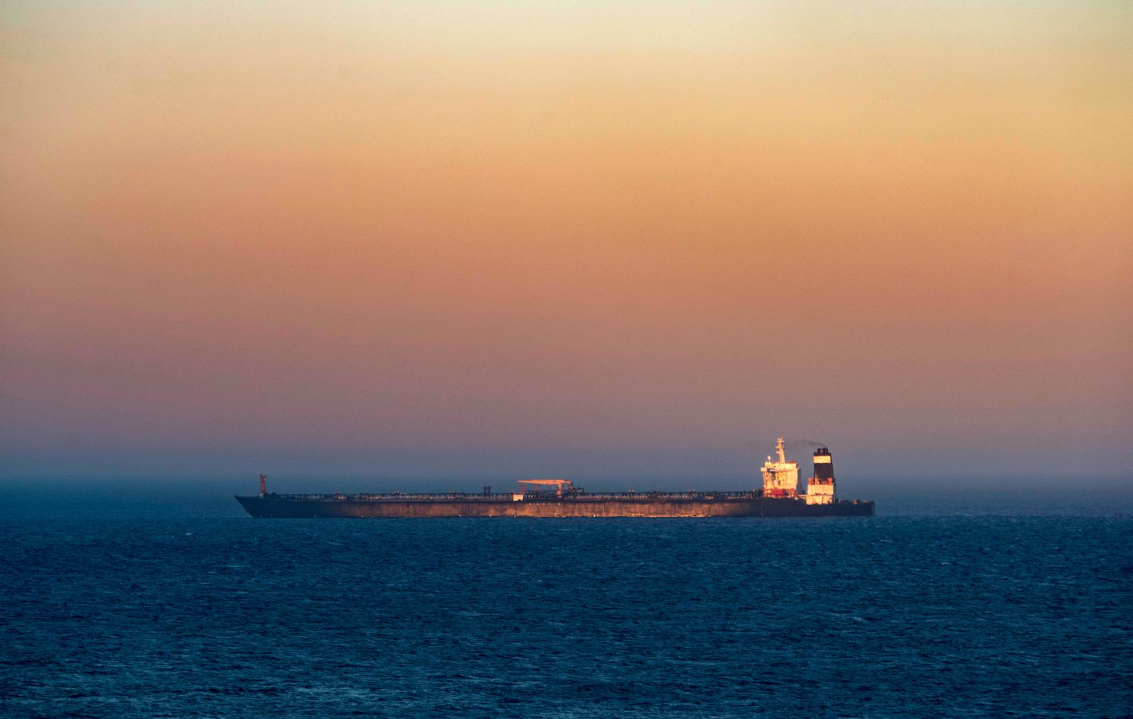 A supertanker hosting an Iranian flag is seen on the water in the British territory of Gibraltar, Sunday, Aug. 18, 2019. . (AP Photo/Marcos Moreno)