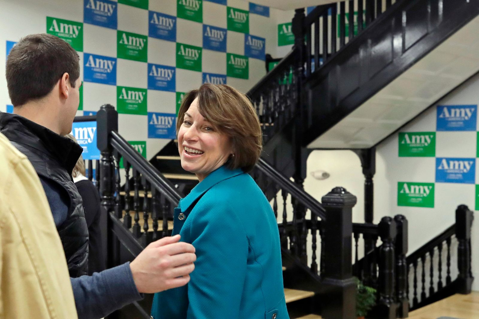 Democratic presidential candidate Sen. Amy Klobuchar, D-Minn., turns to say goodbye on her way out of a campaign event, Tuesday, Dec. 3, 2019, in Milford, N.H. (AP Photo/Elise Amendola)