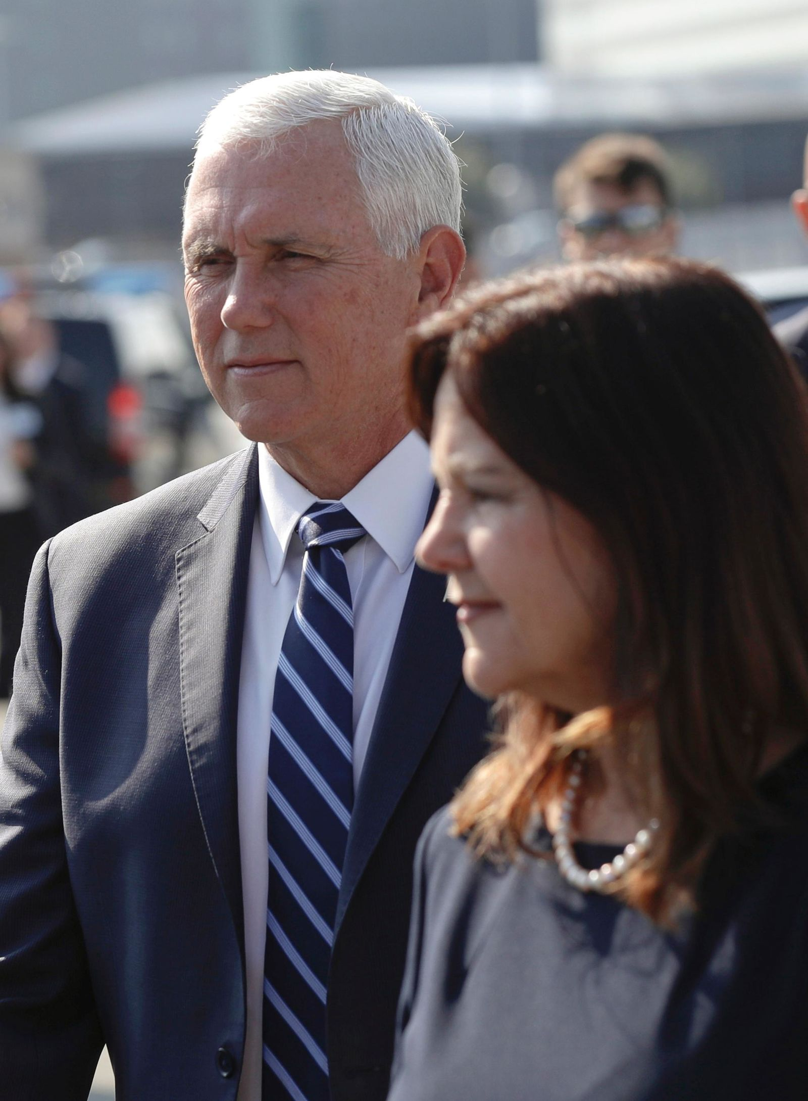 U.S. Vice President Mike Pence and his wife Karen wave arrive in Warsaw, Poland, Sunday, Sept. 1, 2019. Pence will attend a memorial ceremony marking the 80th anniversary of the start of World War II. (AP Photo/Petr David Josek)