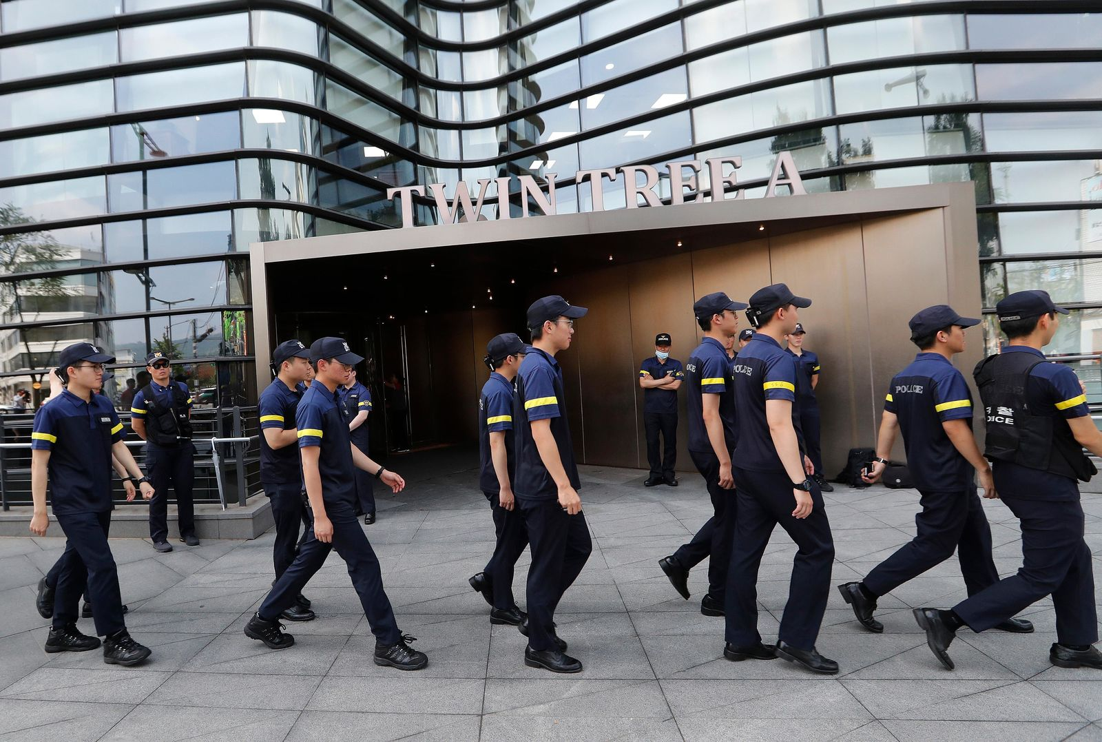 South Korean police officers patrol against possible rallies against Japan in front of a building where the Japanese embassy is located in Seoul, South Korea, Friday, July 19, 2019. South Korean police say a man has set himself on fire in front of the (AP Photo/Ahn Young-joon)
