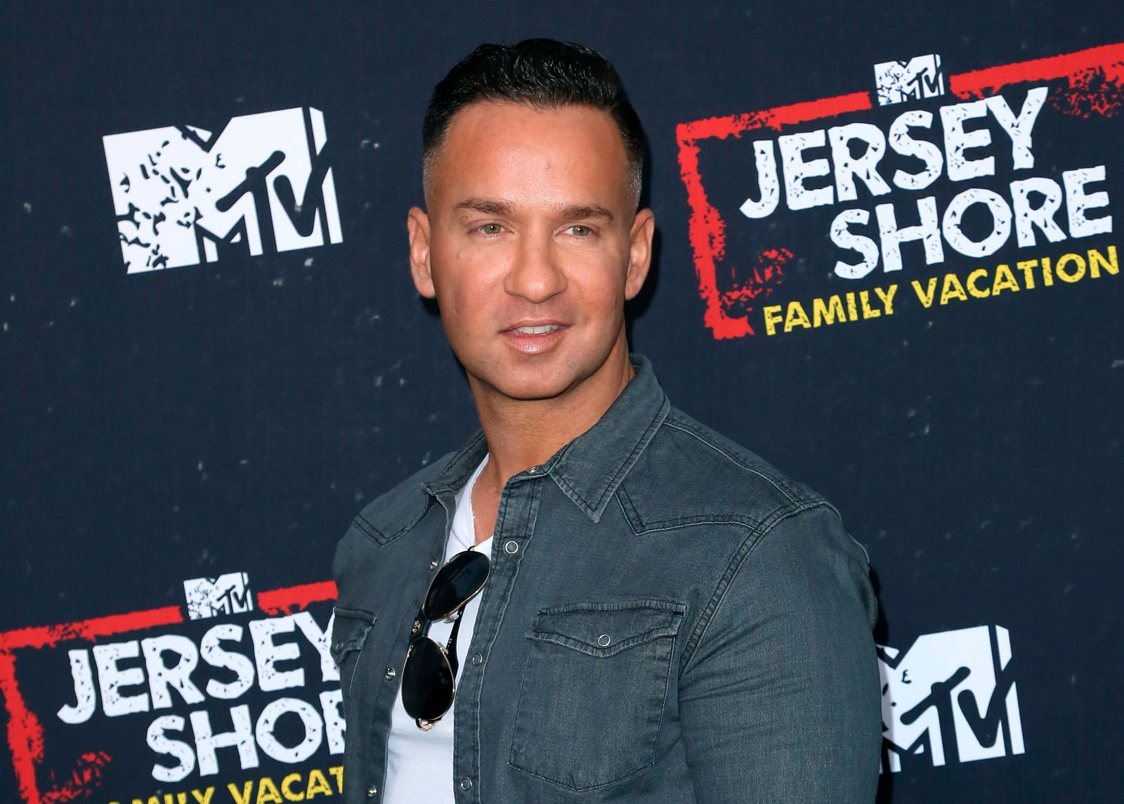 "FILE - In this March 29, 2018 file photo, Mike ""The Situation"" Sorrentino arrives at the ""Jersey Shore Family Vacation"" premiere in Los Angeles. (Photo by Willy Sanjuan/Invision/AP, File)"