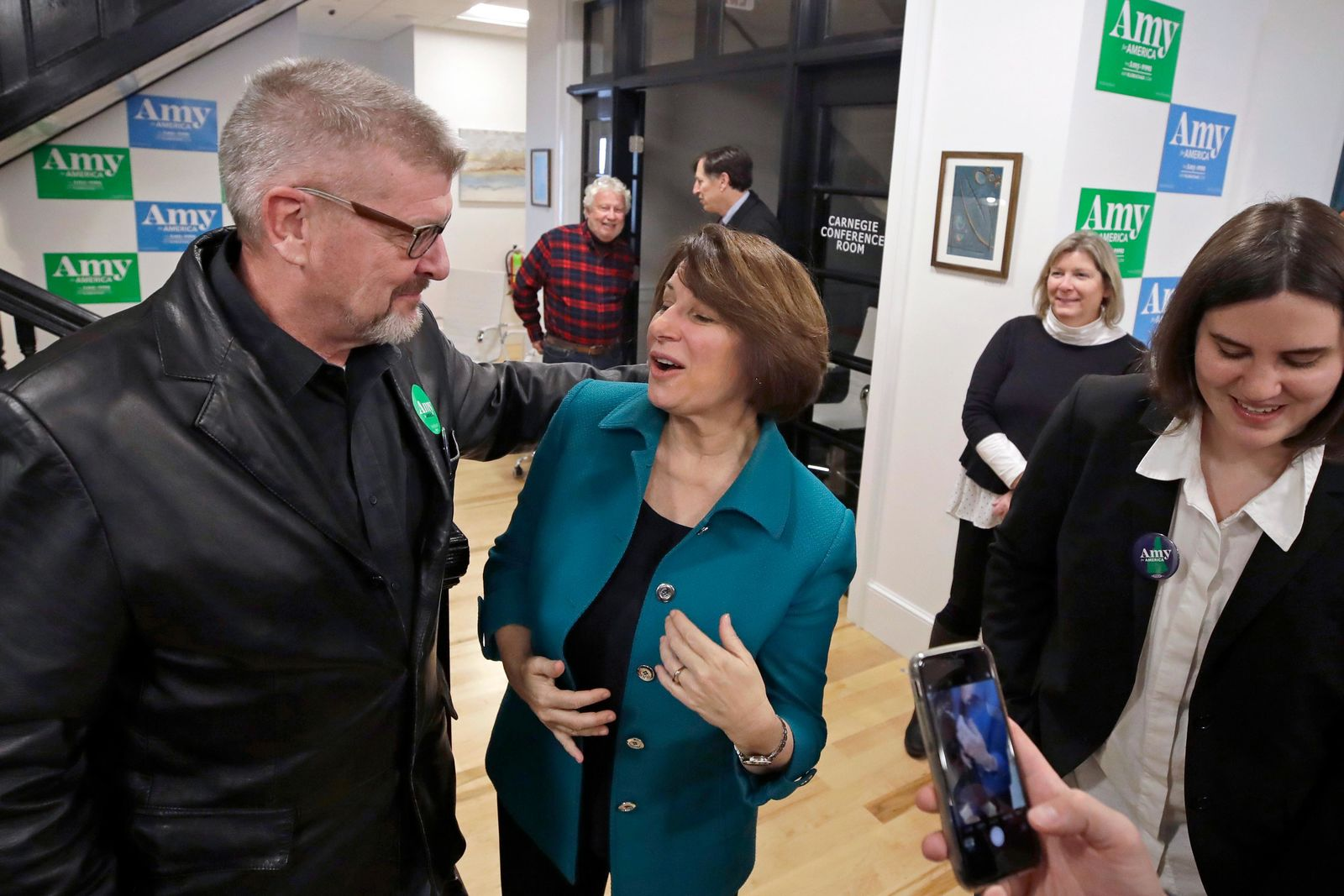 Democratic presidential candidate Sen. Amy Klobuchar, D-Minn., speaks to a potential voter at a campaign event, Tuesday, Dec. 3, 2019, in Milford, N.H. (AP Photo/Elise Amendola)