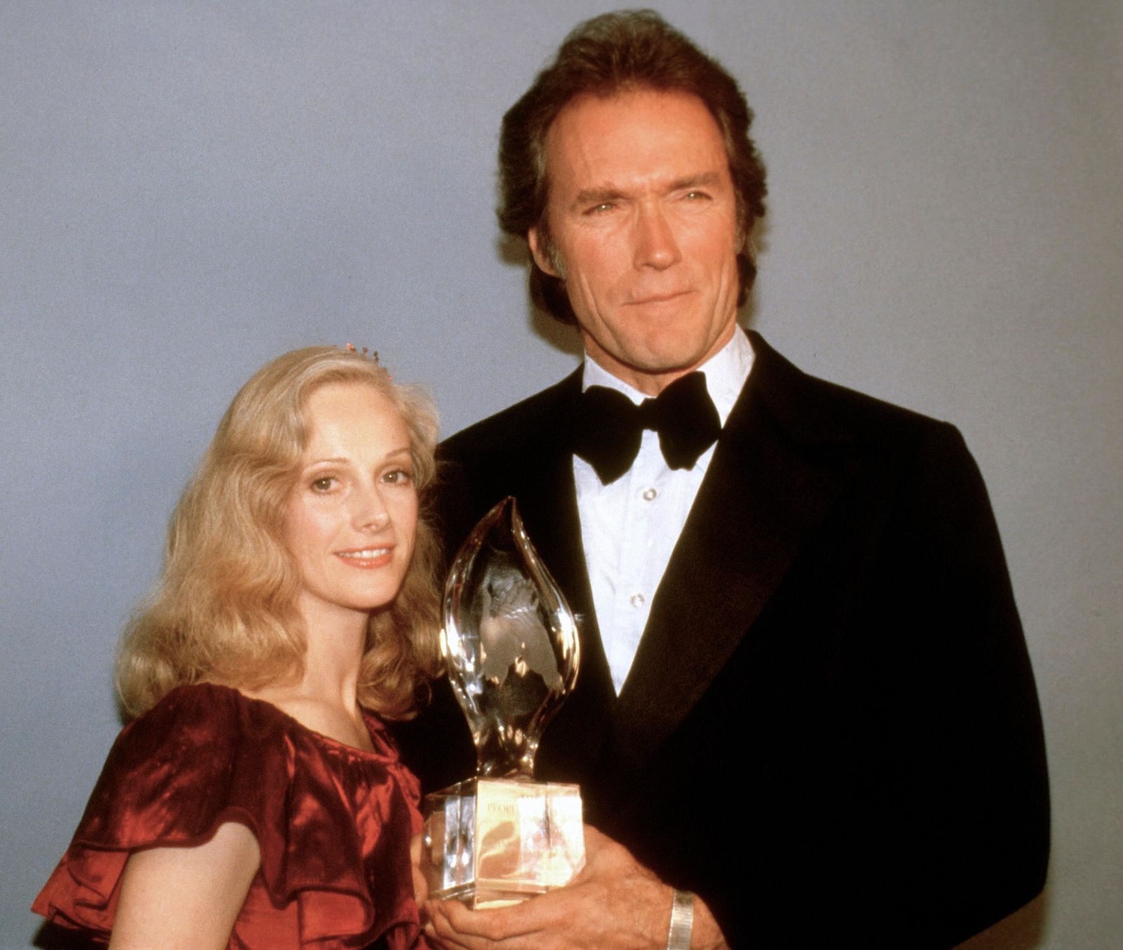 FILE - In this March 5, 1981 file photo, Clint Eastwood poses with his girlfriend Sondra Locke, left, and his People's Choice Award for favorite motion picture actor in Los Angeles. (AP Photo, File)