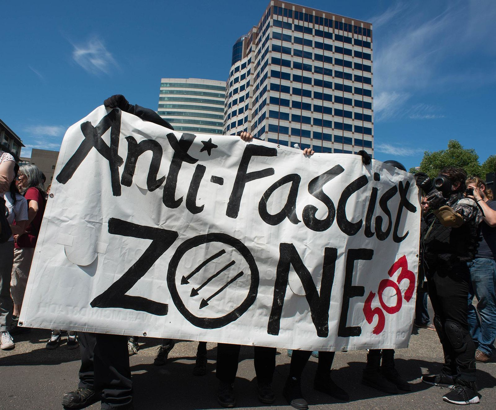 Patriot Prayer, antifa potesters face off at the Portland Waterfront Saturday, August 4, 2018 (KATU photo by Tristan Fortsch on August 4, 2018)