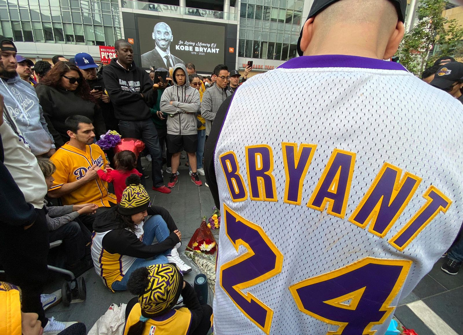 Fans mourn the loss of Kobe Bryant with makeshift memorials in front of La Live across from Staples Center, home of the Los Angeles Lakers in Los Angeles on Sunday, Jan, 26, 2020. Bryant, the 18-time NBA All-Star who won five championships and became one of the greatest basketball players of his generation during a 20-year career with the Los Angeles Lakers, died in a helicopter crash Sunday. (Keith Birmingham/The Orange County Register via AP)