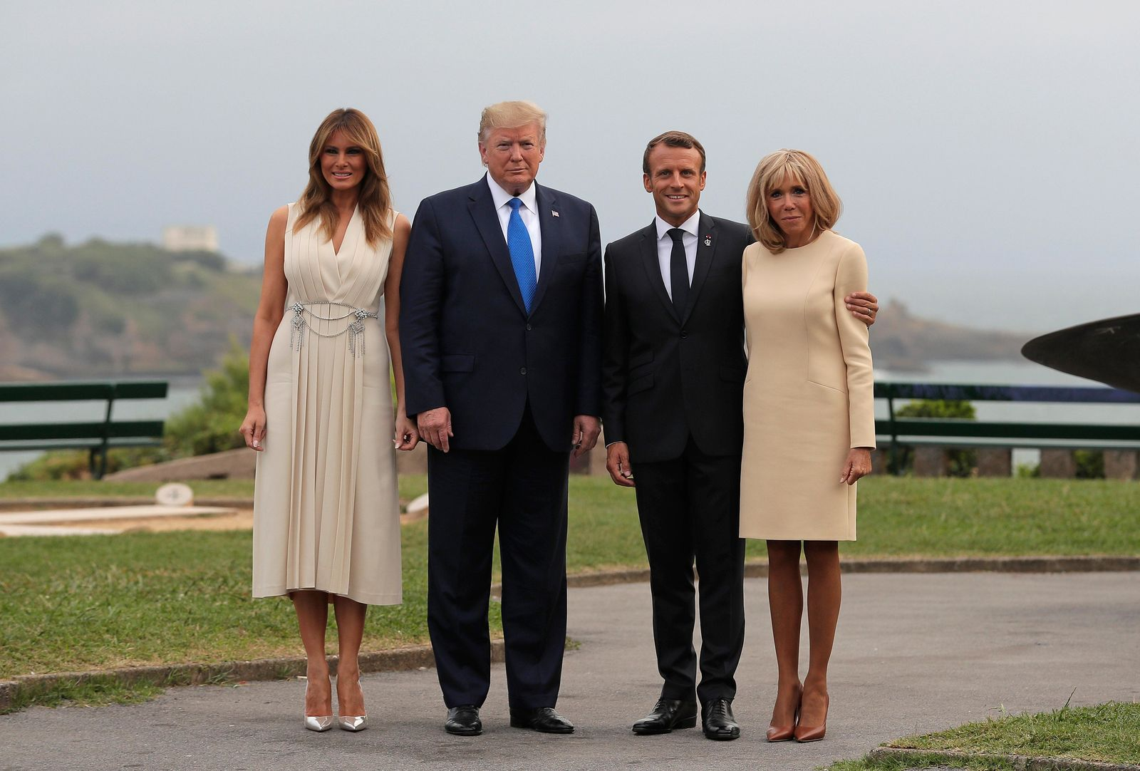 French President Emmanuel Macron and his wife Brigitte welcome President Donald Trump and first lady Melania Trump at the Biarritz lighthouse, southwestern France, ahead of a working dinner Saturday, Aug.24, 2019. Shadowed by the threat of global recession, a U.S. trade war with China and the possibility of one against Europe, the posturing by leaders of the G-7 rich democracies began well before they stood together for a summit photo. (AP Photo/Markus Schreiber)