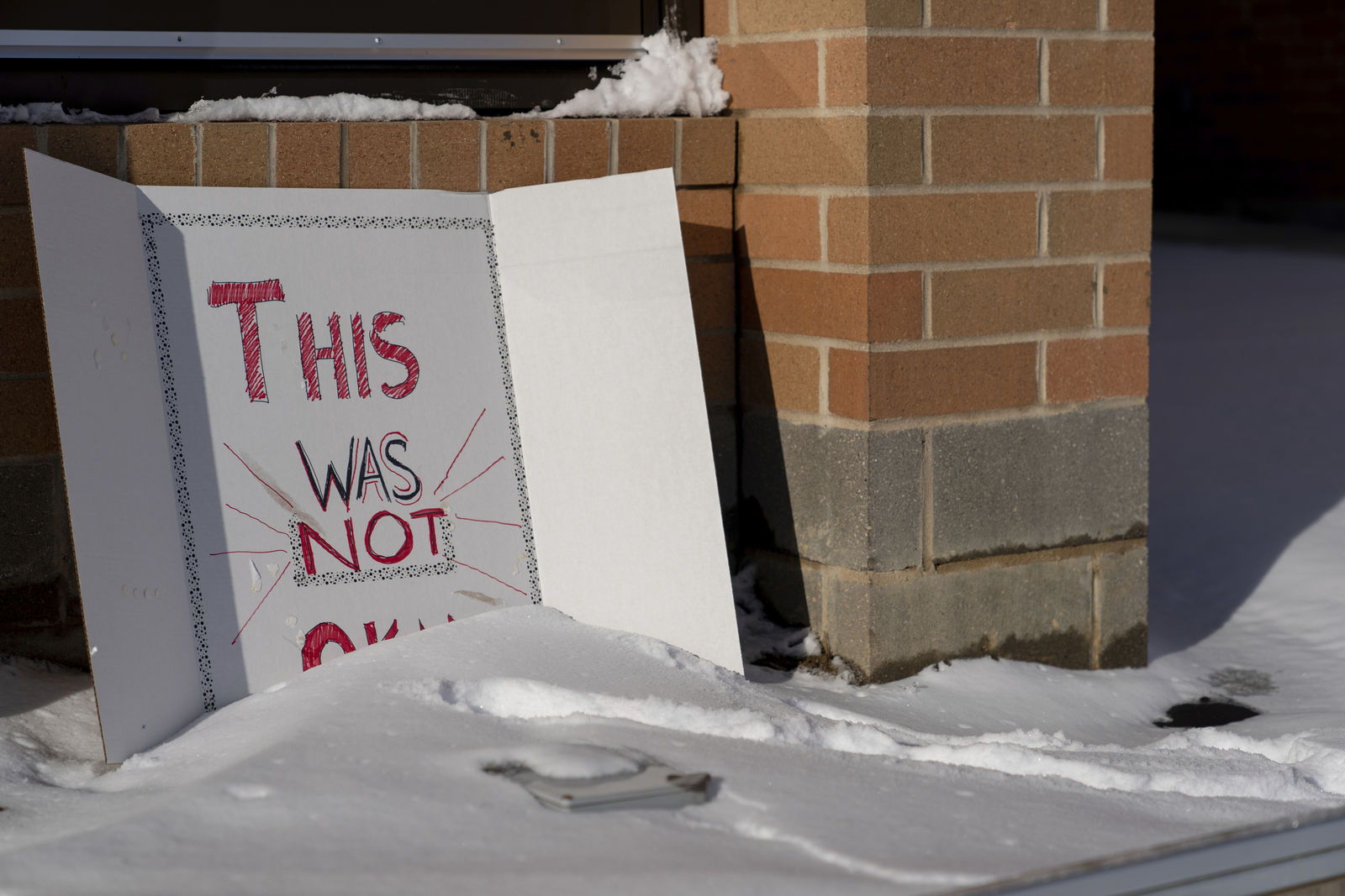 "A sign reading ""This was not okay,"" is seen in front of Covington Catholic High School in Park Kills, Ky., Sunday, Jan 20, 2019. (AP Photo/Bryan Woolston)"