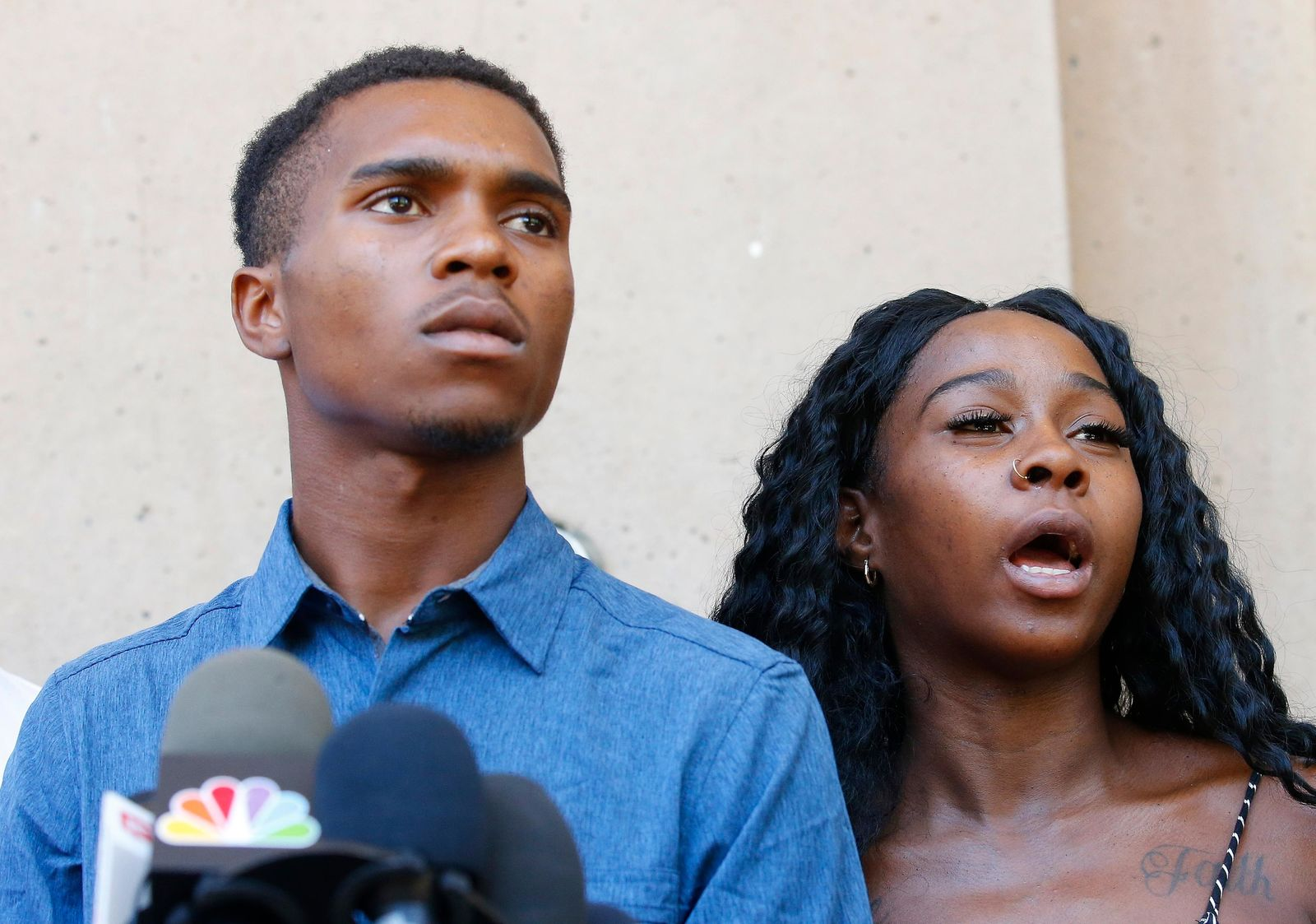 Iesha Harper, right, answers a question during a news conference as she is joined by her fiancee Dravon Ames, left, at Phoenix City Hall, Monday, June 17, 2019, in Phoenix. (AP Photo/Ross D. Franklin)