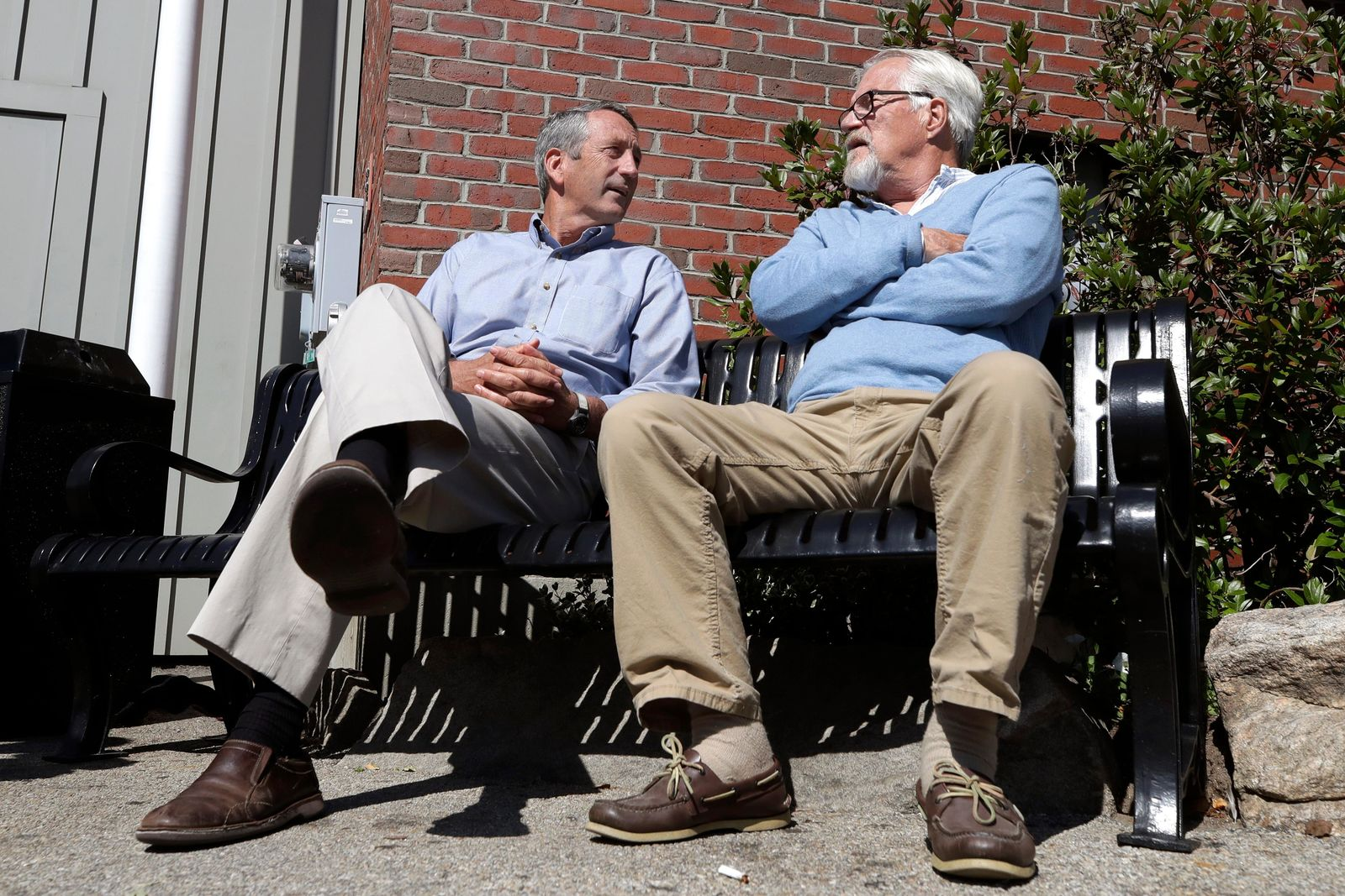 Republican presidential candidate former South Carolina Gov. Mark Sanford, left, chats with{ }Ken Demick, of Manchester, N.H., as he campaigns, Thursday, Sept. 19, 2019, in Manchester. (AP Photo/Elise Amendola)