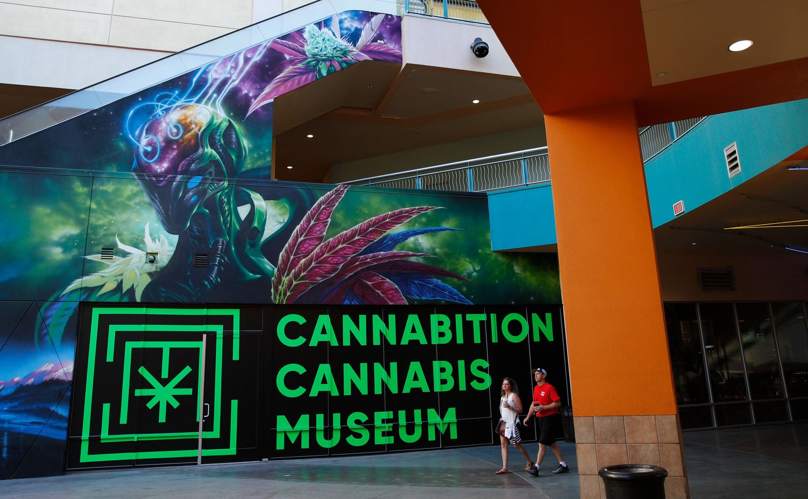 In this Tuesday, Sept. 18, 2018 photo, people walk by the Cannabition cannabis museum in Las Vegas. (AP Photo/John Locher)