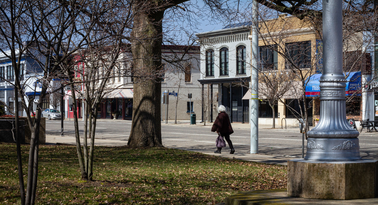 A Kalamazoo resident walks down the sidewalk on West Michigan Ave on Wednesday, March 25.{ }(WWMT/Sarah White)