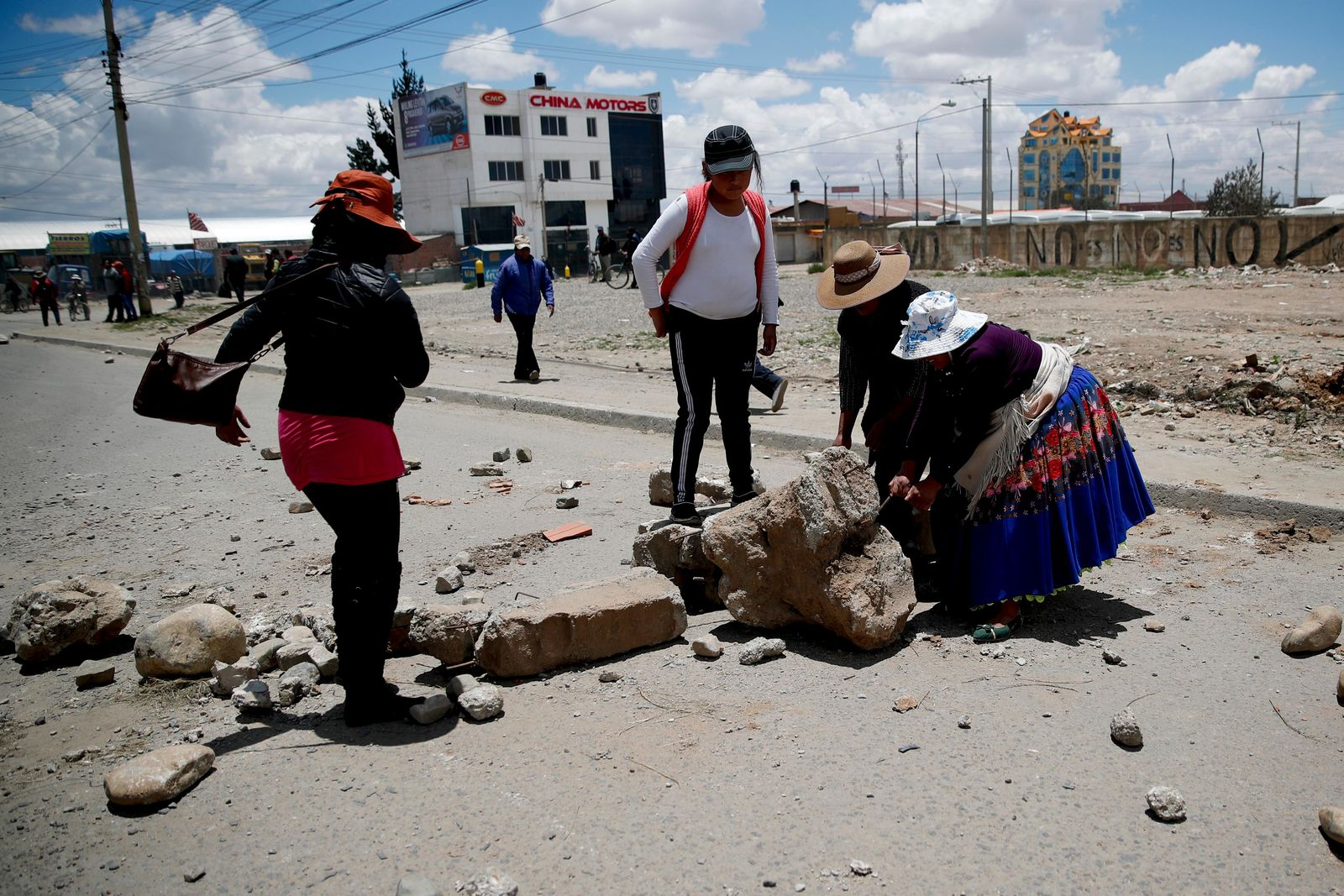 Supporters of former President Evo Morales set up barricades at the road leading to a gas plant in El Alto, on the outskirts of La Paz, Bolivia, Tuesday, Nov. 19, 2019.{ } (AP Photo/Natacha Pisarenko)