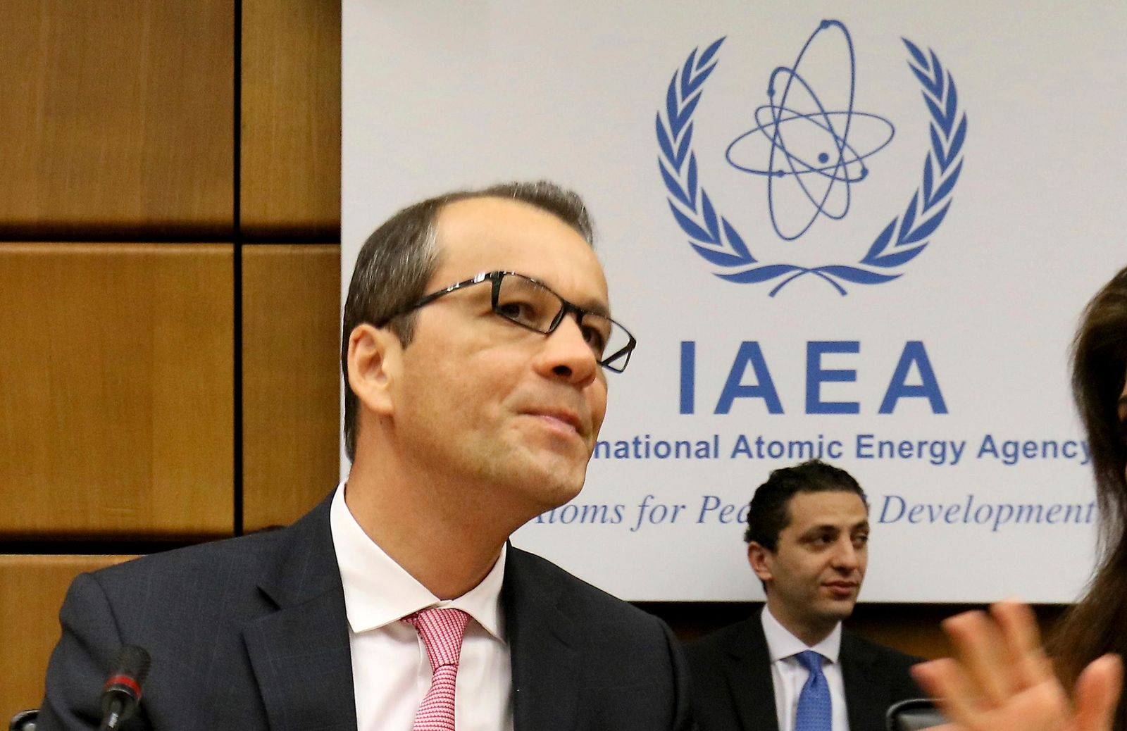 Acting Director General of the International Atomic Energy Agency, IAEA, Cornel Feruta from Romania waits for the start of the IAEA board of governors meeting at the International Center in Vienna, Austria, Thursday, Aug. 1, 2019. (AP Photo/Ronald Zak)