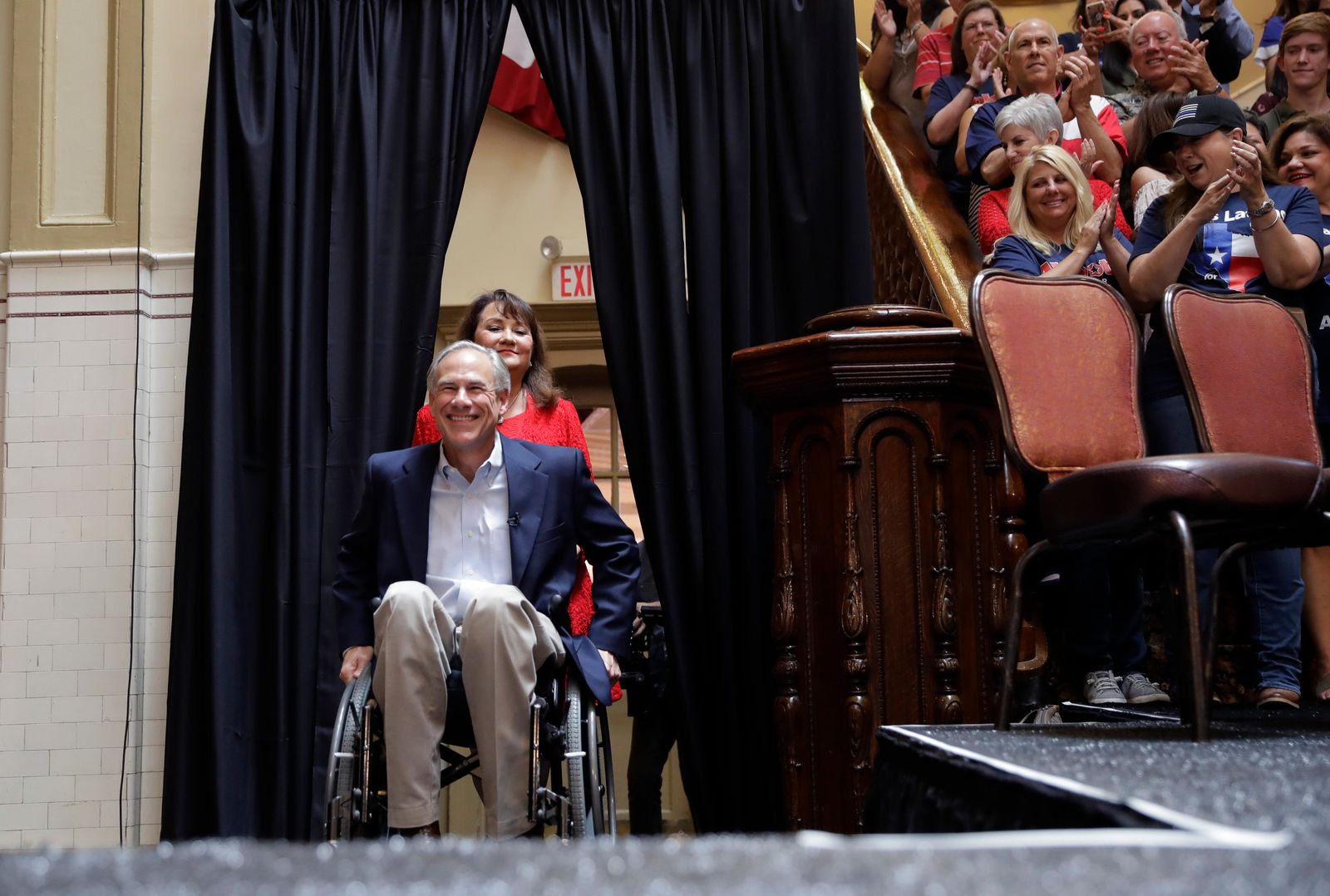 Texas Gov. Greg Abbott, left, followed by his wife Cecilia arrive for an event where he announced his bid for re-election, Friday, July 14, 2017, in San Antonio. (AP Photo/Eric Gay)