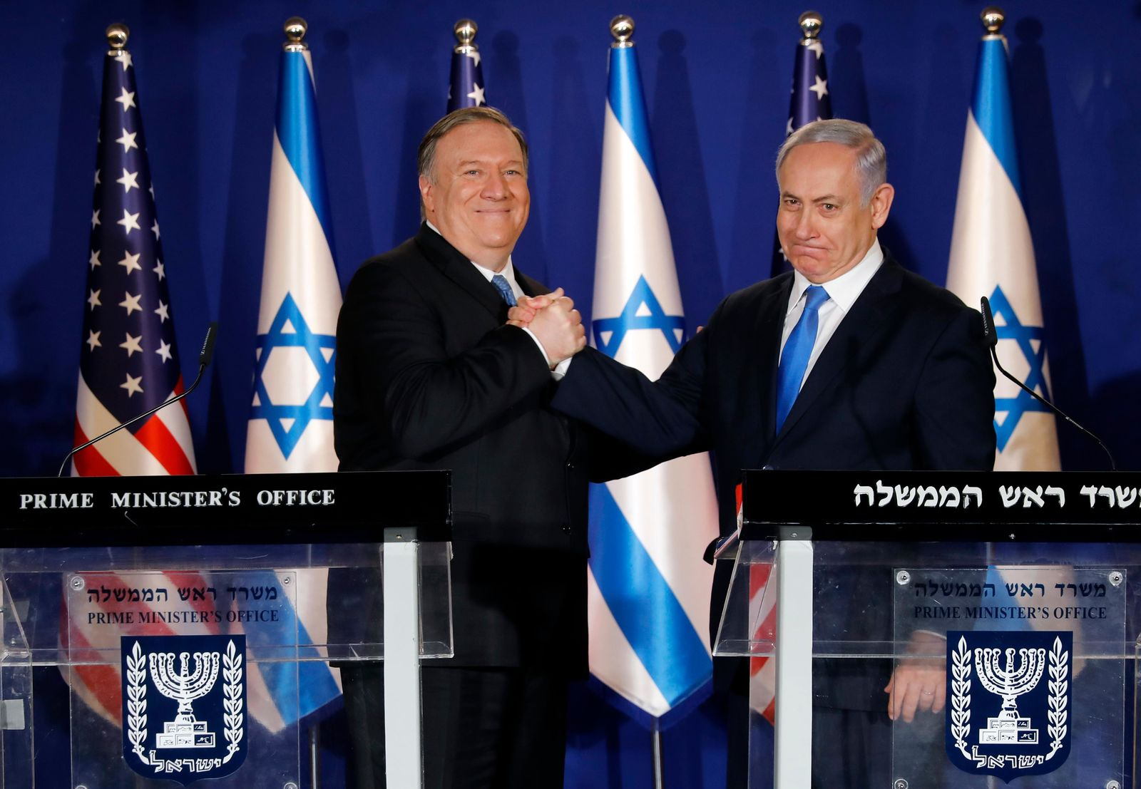 U.S. Secretary of State Mike Pompeo, left, shakes hands with Israeli Prime Minister Benjamin Netanyahu, during their visit to Netanyahu's official residence in Jerusalem, Thursday March 21, 2019.{ } (Amir Cohen/Pool via AP)