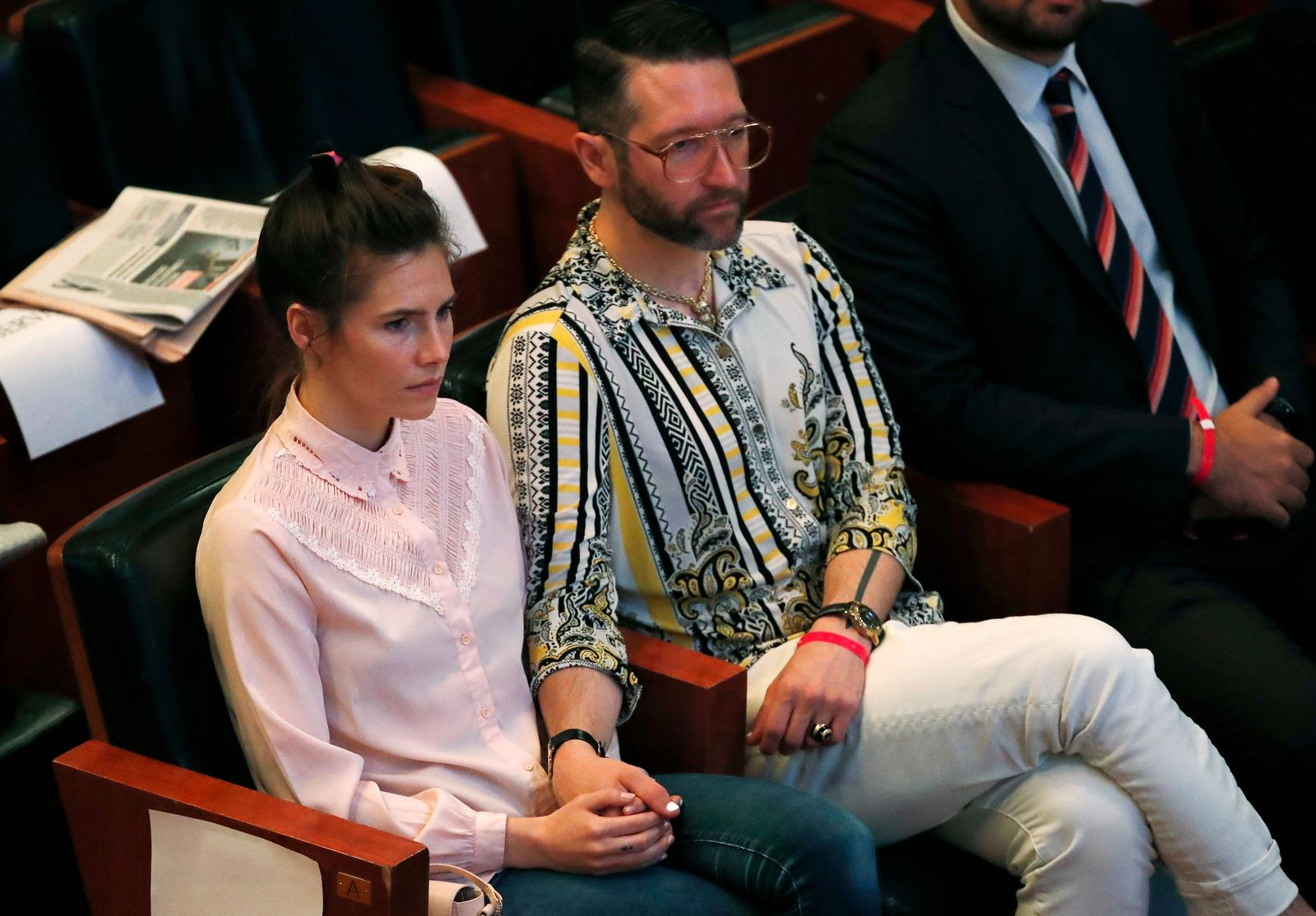 Amanda Knox holds hands with her fiancee Christopher Robinson as they attend a conference during a Criminal Justice Festival at the University of Modena, Italy, Friday, June, 2019.{ } (AP Photo/Antonio Calanni)