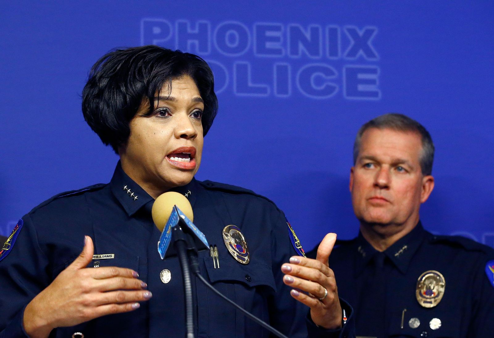 Phoenix Police Chief Jeri Williams, left, announces the arrest of Nathan Sutherland, a licensed practical nurse, on one count of sexual assault and one count of vulnerable adult abuse on an incapacitated woman who gave birth last month at a long-term health care facility Wednesday, Jan. 23. (AP Photo/Ross D. Franklin)