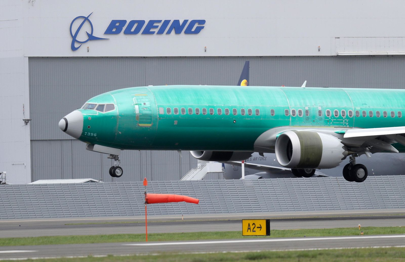 FILE - In this April 10, 2019, file photo a Boeing 737 MAX 8 airplane being built for India-based Jet Airways lands following a test flight at Boeing Field in Seattle.{ } (AP Photo/Ted S. Warren, File)