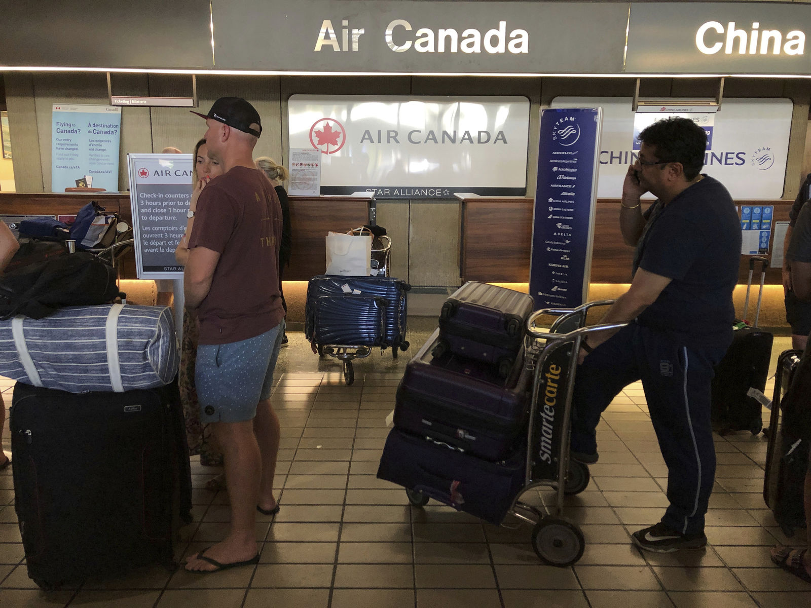 Passengers from an Australia-bound Air Canada flight diverted to Honolulu Thursday, July 11, 2019, after about 35 people were injured during turbulence. (AP Photo/Caleb Jones)